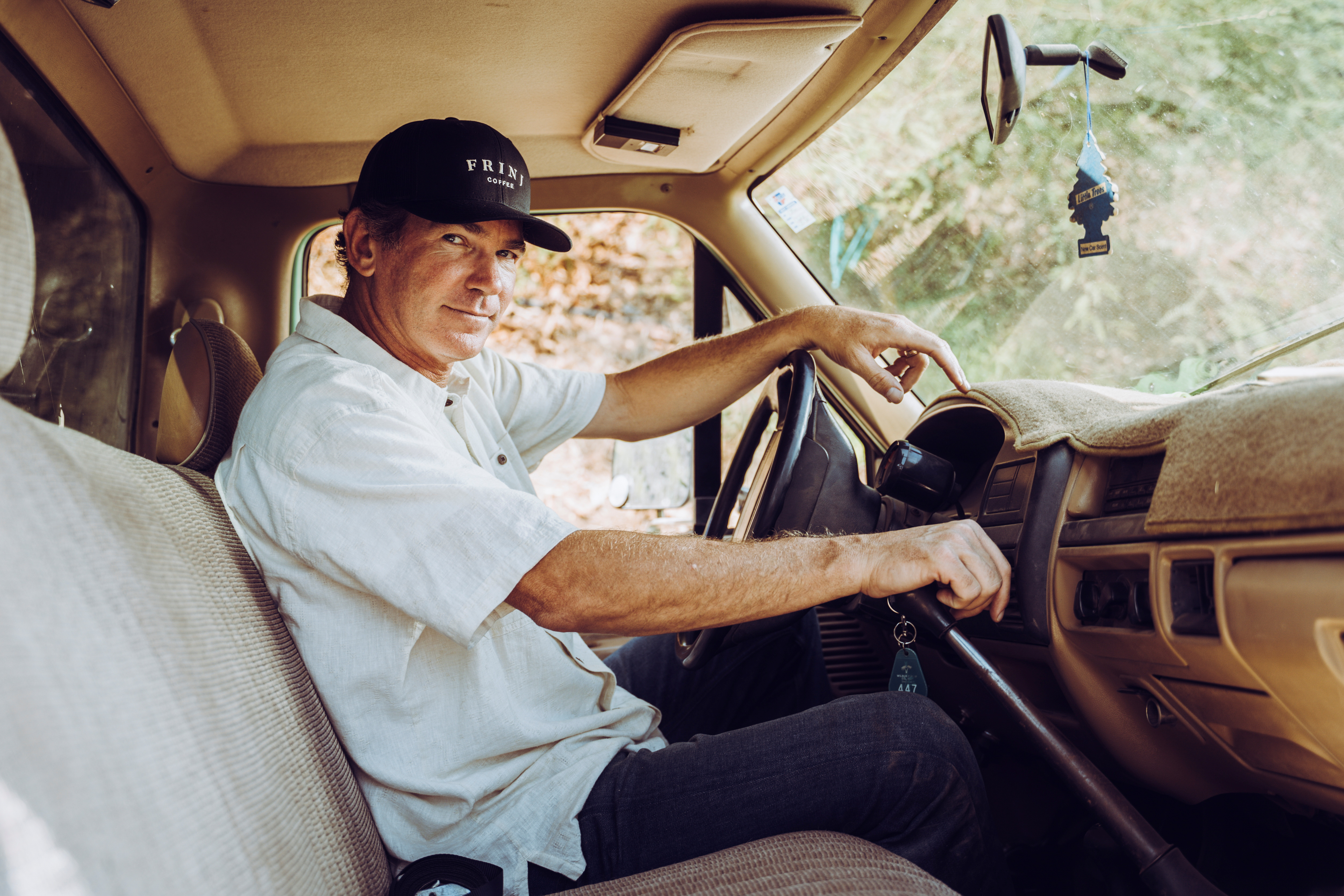 Farmer Jay Ruskey, the Chief Executive of FRINJ Coffee, drives his truck around his farm in California, where he planted coffee trees, U.S., in this picture obtained by Reuters on September 20, 2021. FRINJ Coffee/Handout via REUTER