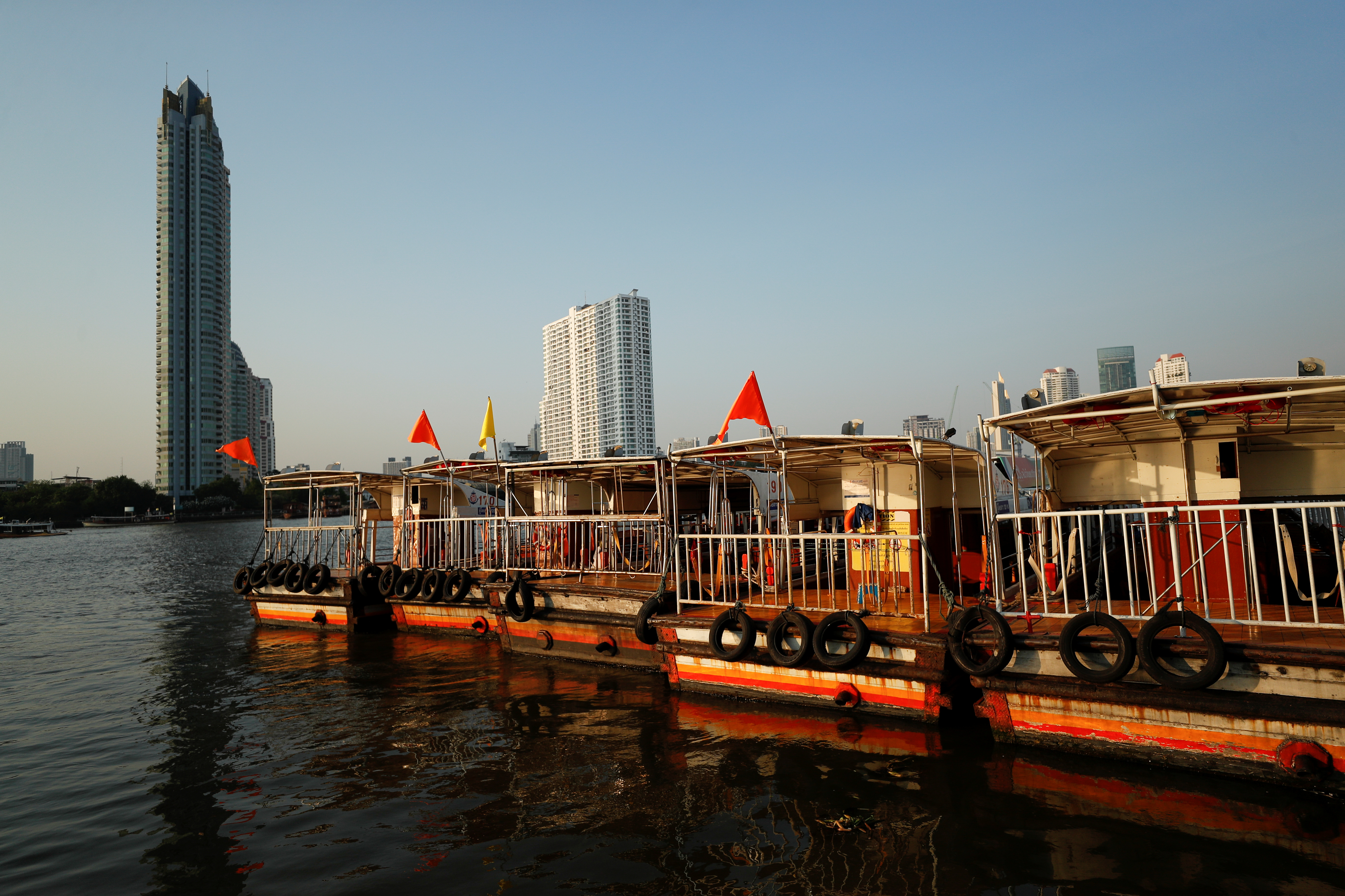 Boats that are used to transport tourists around the Chao Phraya river are seen idle due to travel bans and border closures from the global coronavirus disease (COVID-19) outbreak in downtown Bangkok, Thailand February 4, 2021. Picture taken February 4, 2021. REUTERS/Jorge Silva