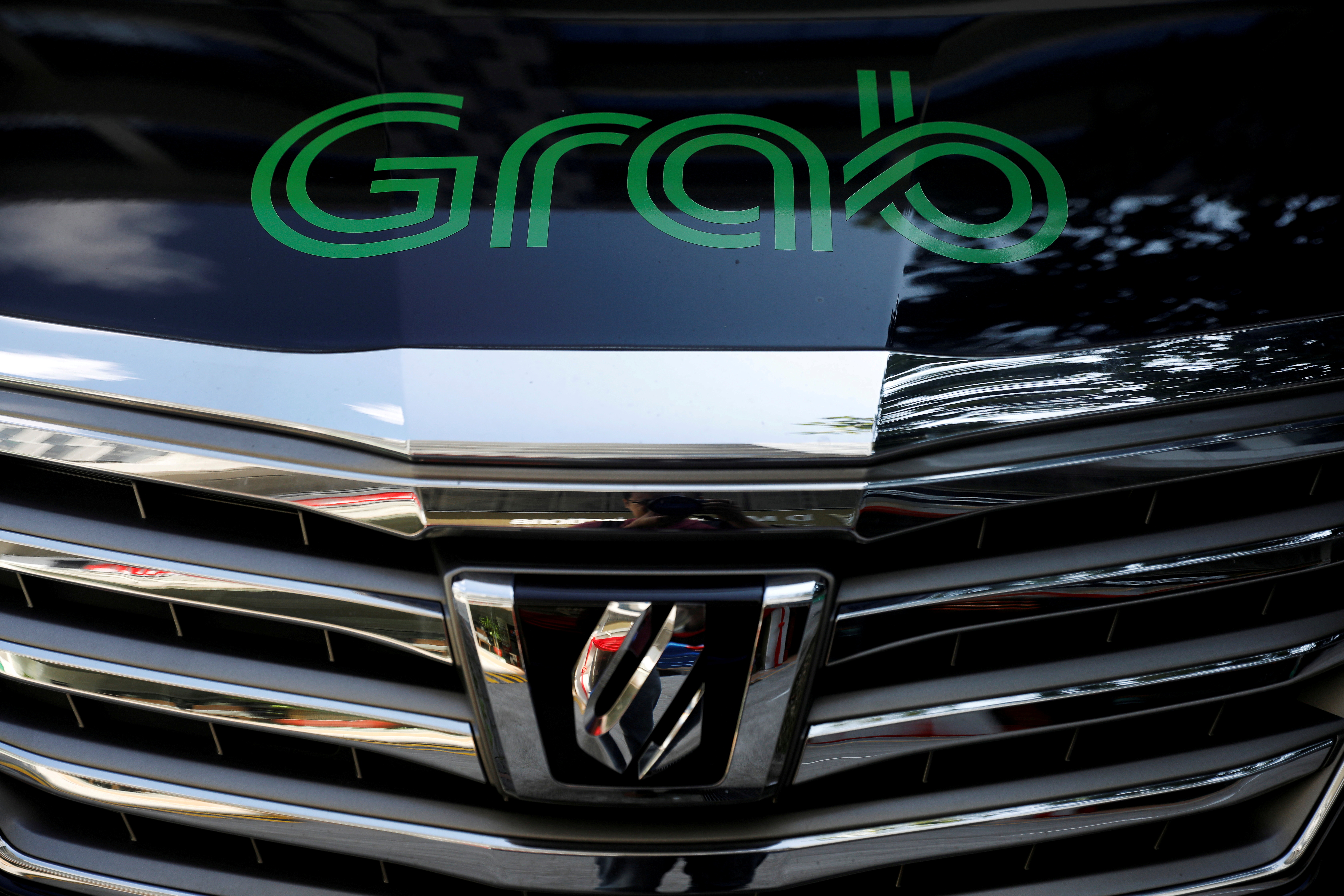 A Grab vehicle is pictured in Singapore March 26, 2018. REUTERS/Edgar Su