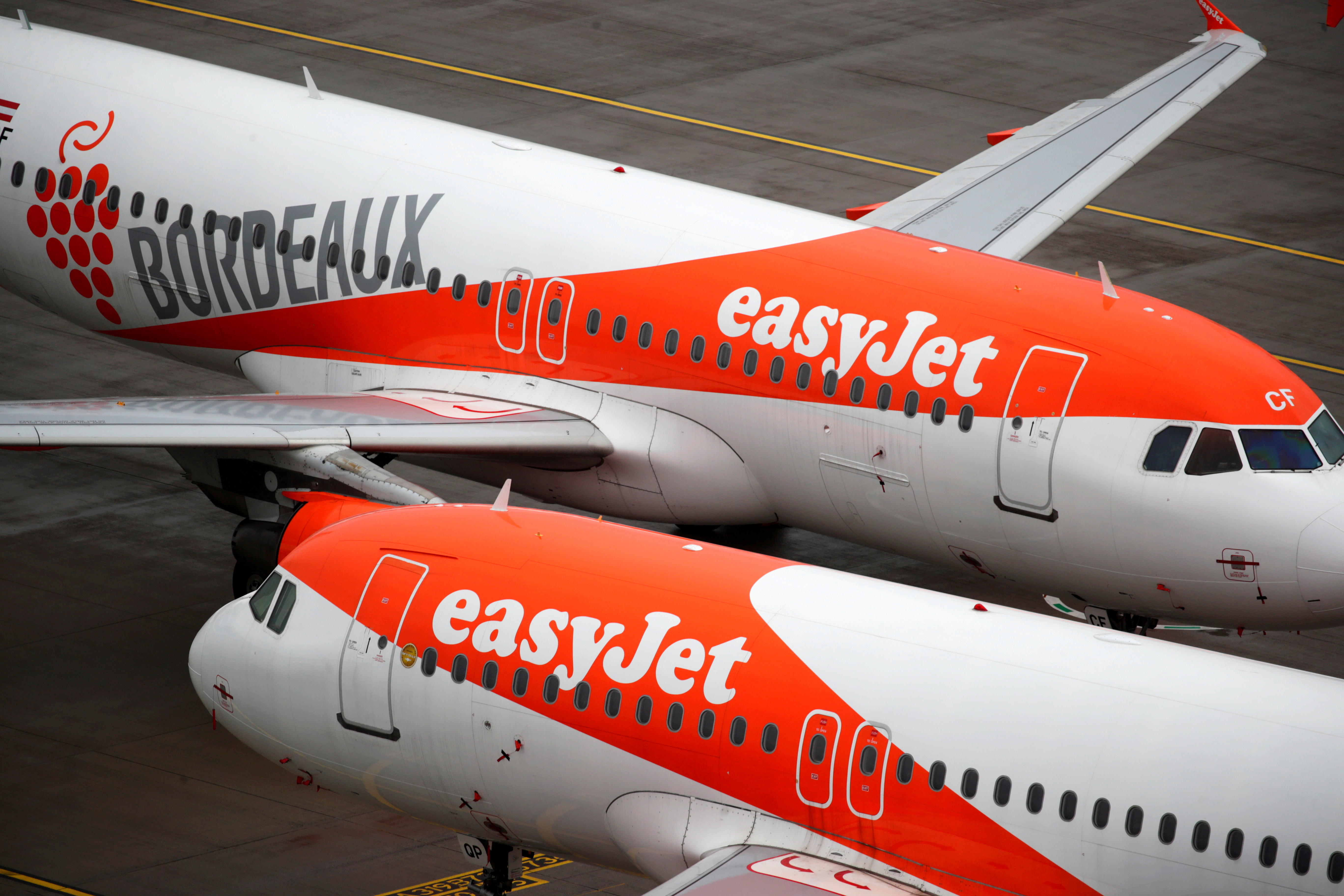 """EasyJet aircrafts are seen on the tarmac at Terminal 1, marking the official opening of the new Berlin-Brandenburg Airport (BER) """"Willy Brandt"""", in Schoenefeld near Berlin, Germany October 31, 2020. REUTERS/Hannibal Hanschke/Pool"""