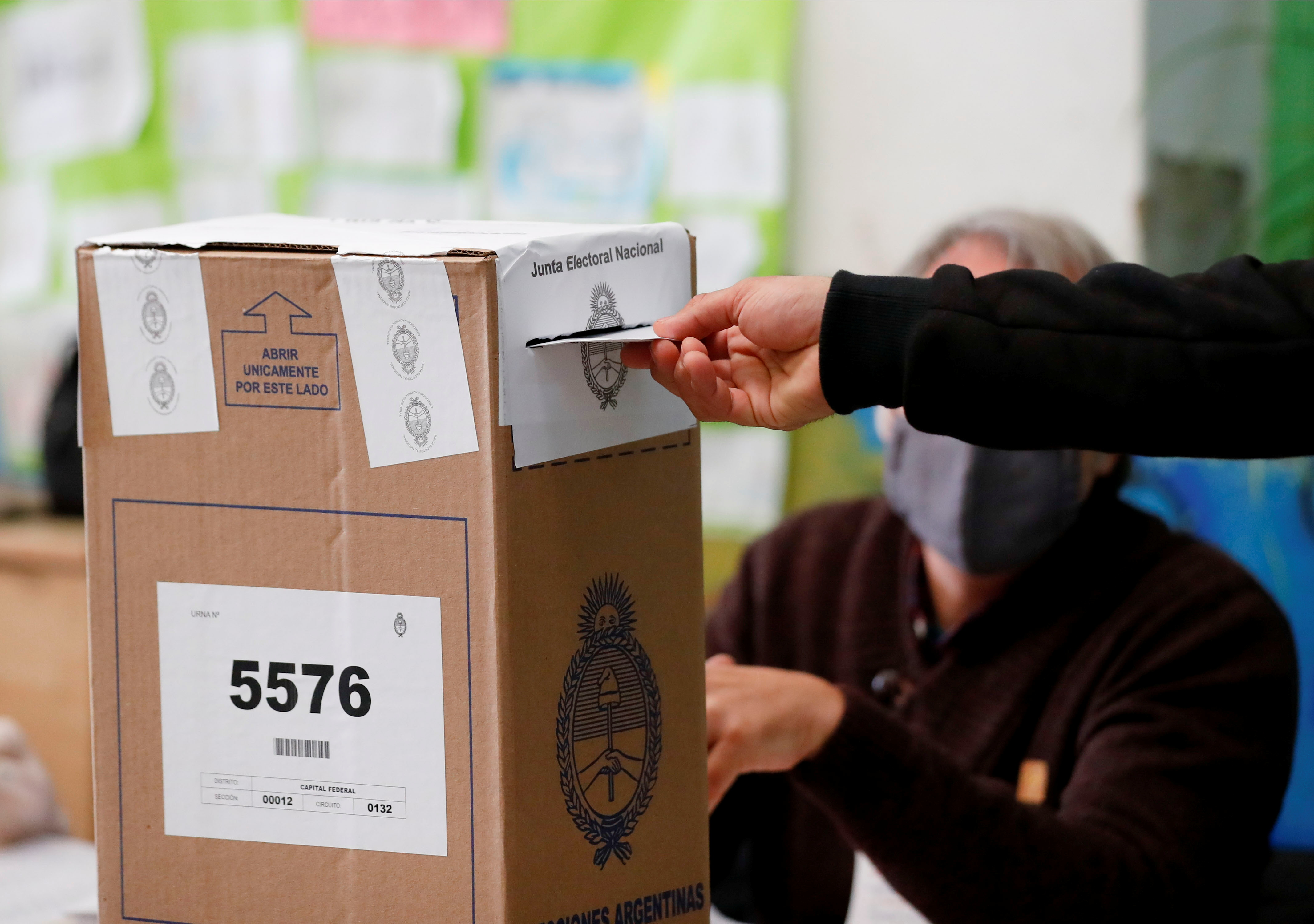 A man casts his vote in a polling station during primary legislative elections, in Buenos Aires, Argentina September 12, 2021. REUTERS/Agustin Marcarian