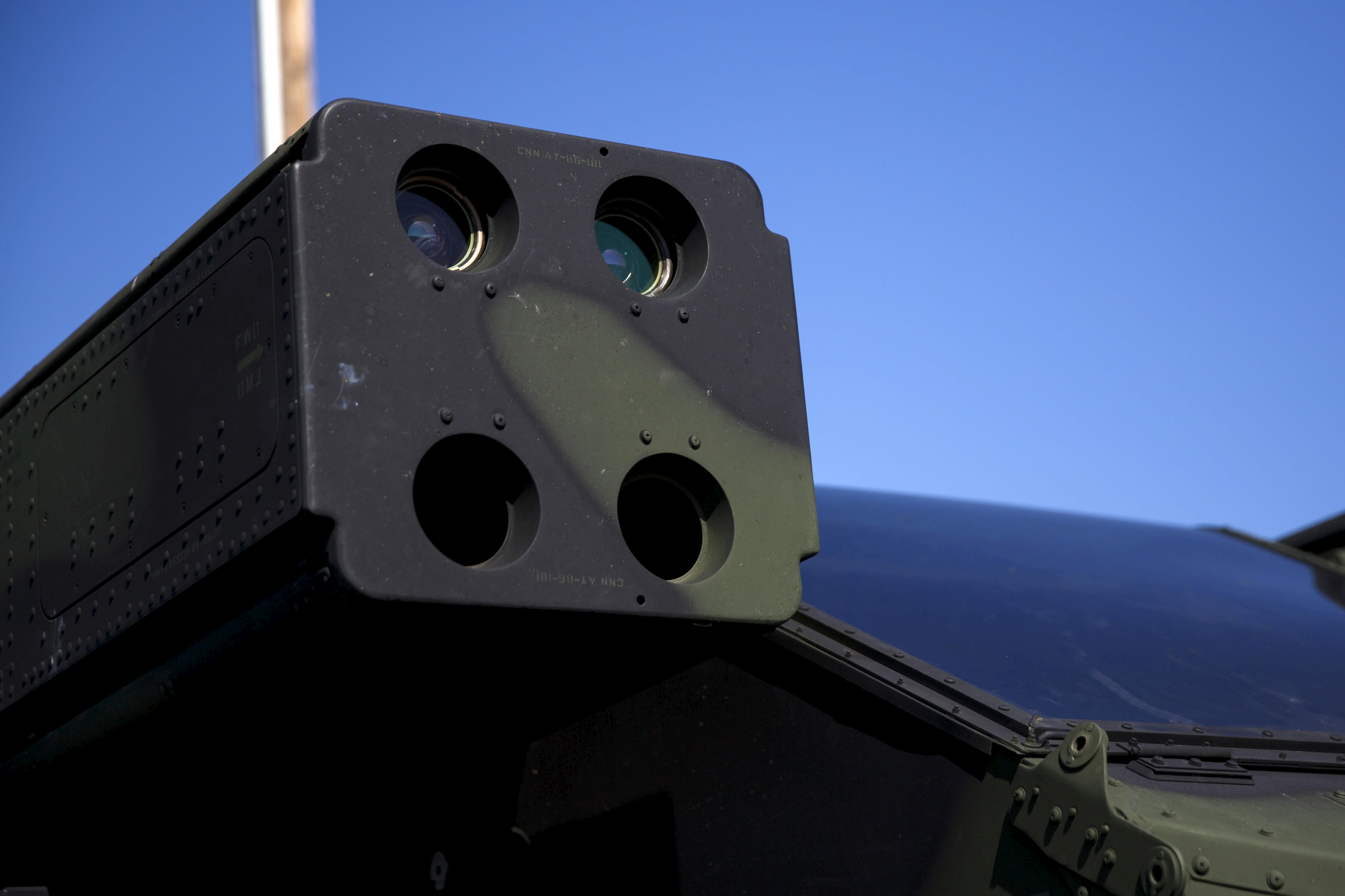 The US Army Avenger Air Defense System (AN/TWQ-1) used to fire Stinger missiles is displayed with two test missiles during