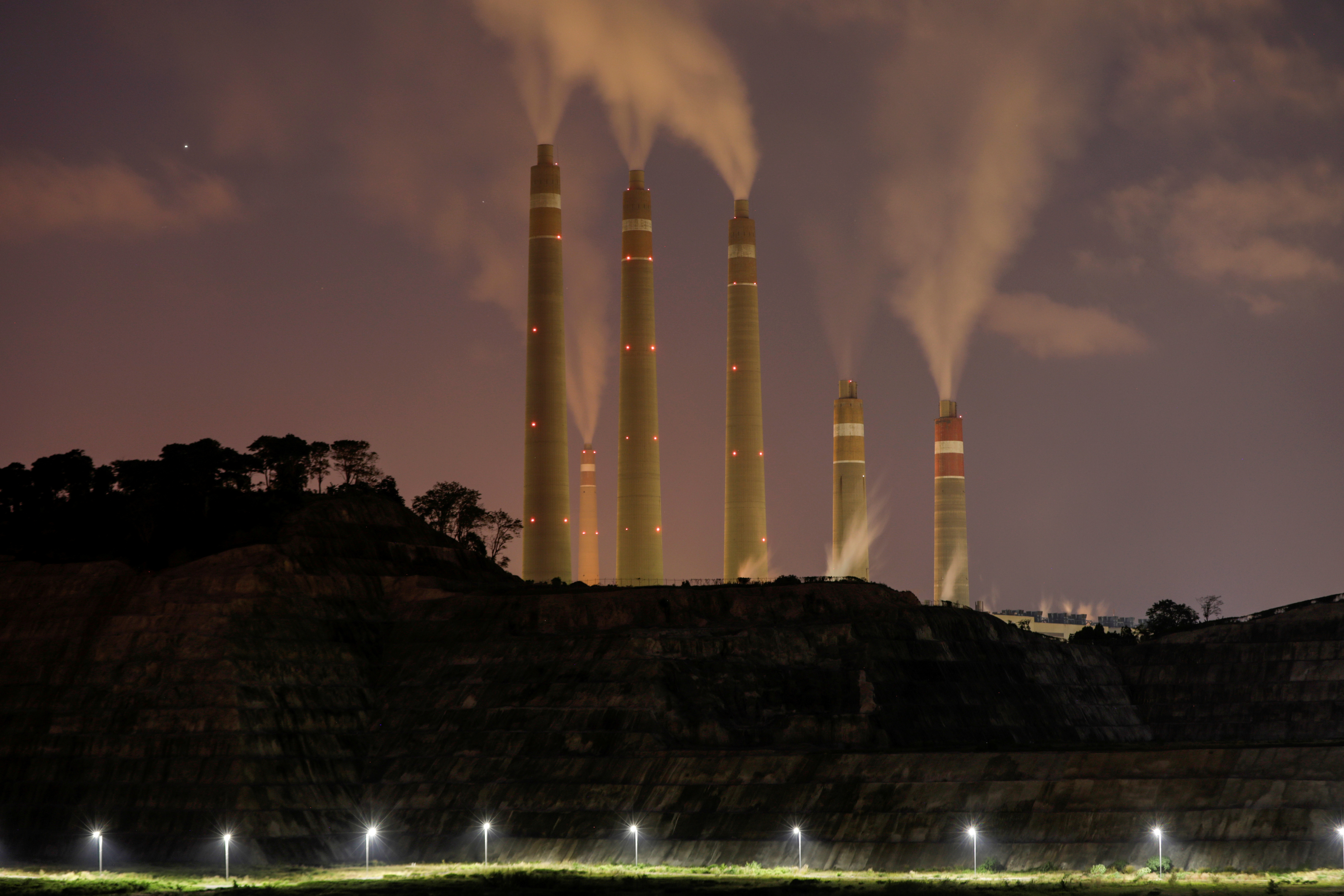 Smoke and steam billows from the coal-fired power plant owned by Indonesia Power, next to an area for Java 9 and 10 Coal-Fired Steam Power Plant Project in Suralaya, Banten province, Indonesia, July 11, 2020. Picture taken July 11, 2020. REUTERS/Willy Kurniawan/File Photo