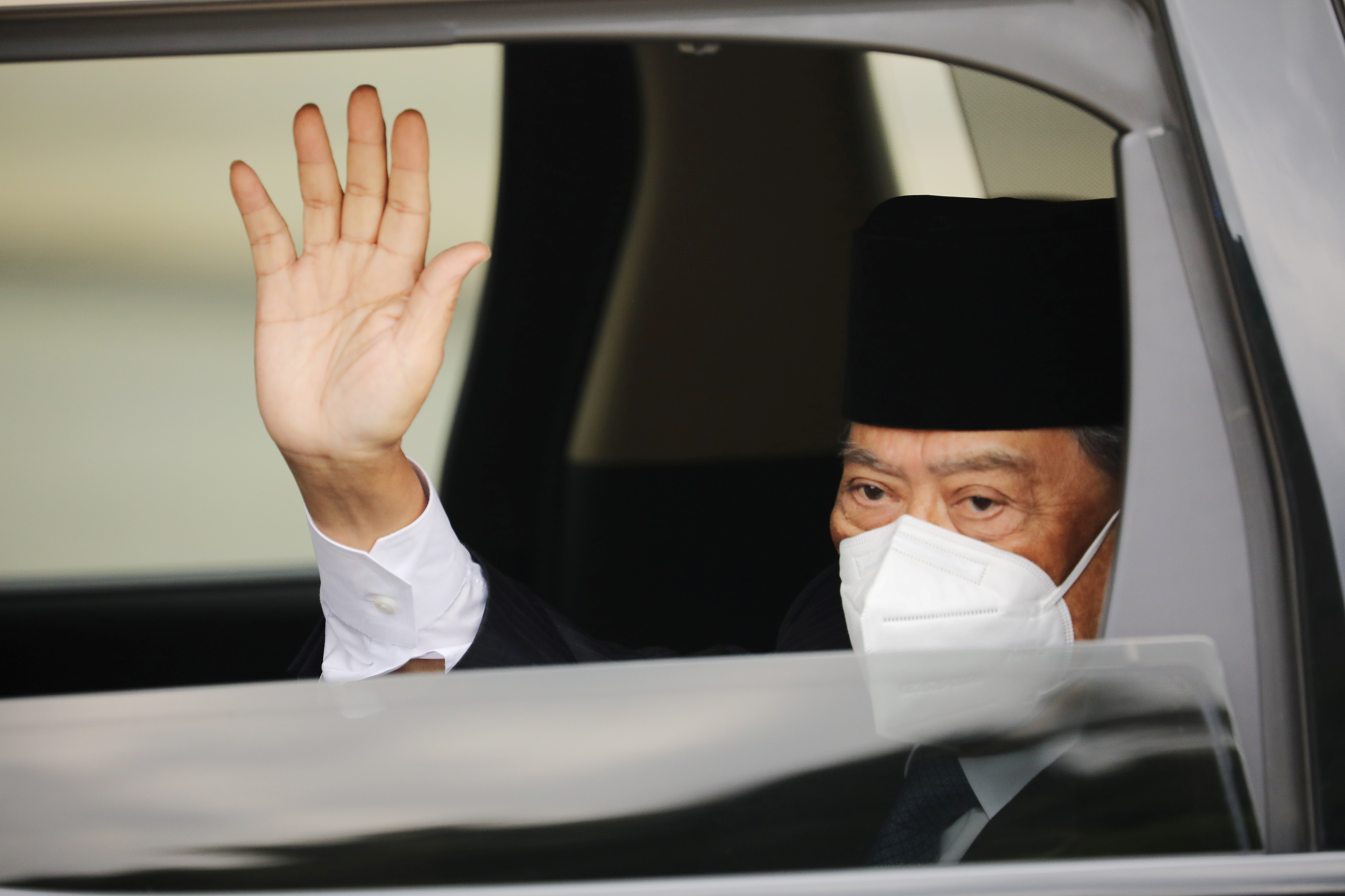 Malaysian Prime Minister Muhyiddin Yassin arrives at the National Palace for a meeting with the king, in Kuala Lumpur, Malaysia August 16, 2021. REUTERS/Lim Huey Teng