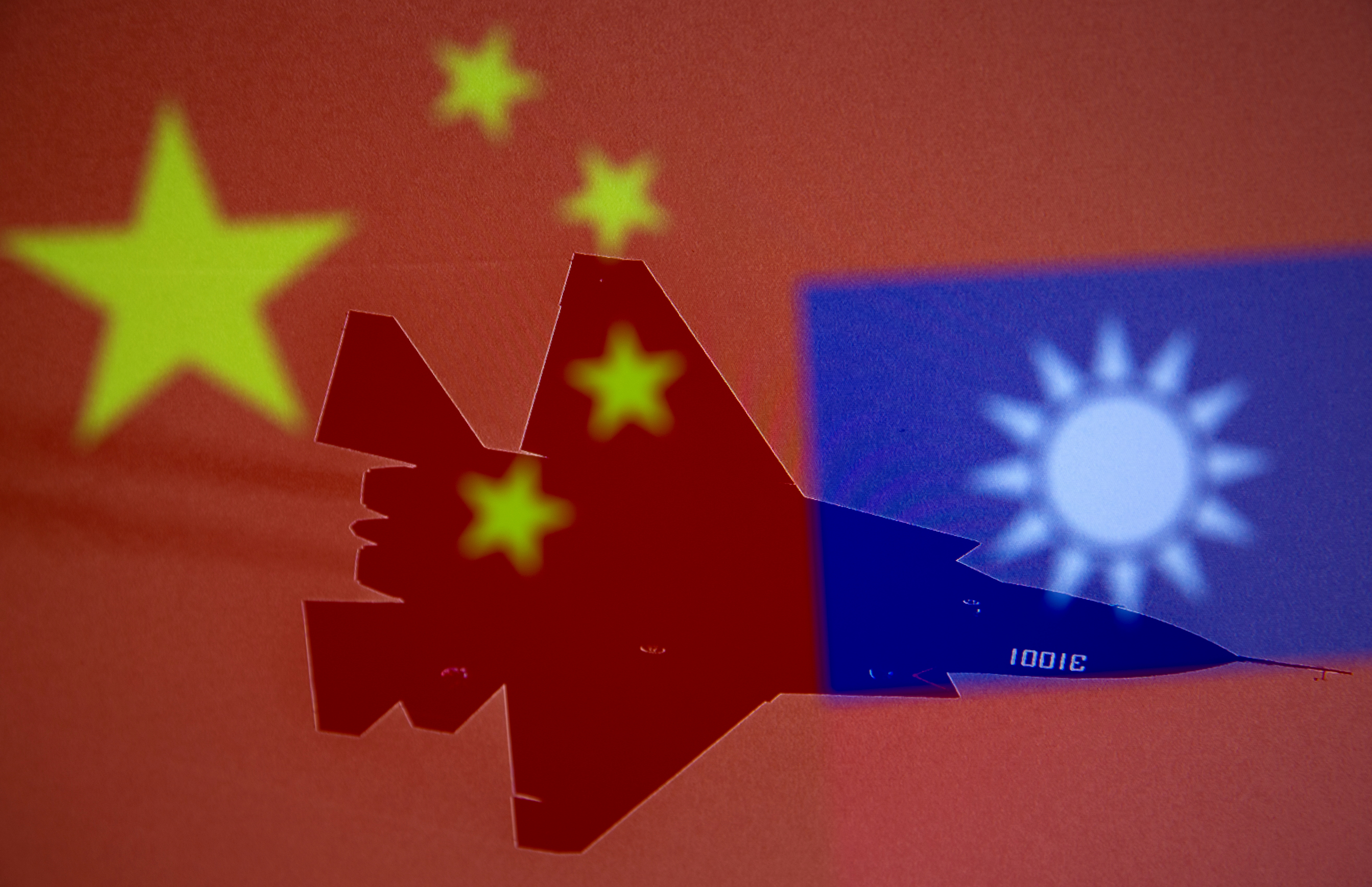 Chinese and Taiwanese national flags are displayed alongside a military airplane in this illustration taken April 9, 2021. REUTERS/Dado Ruvic/Illustration/File Photo