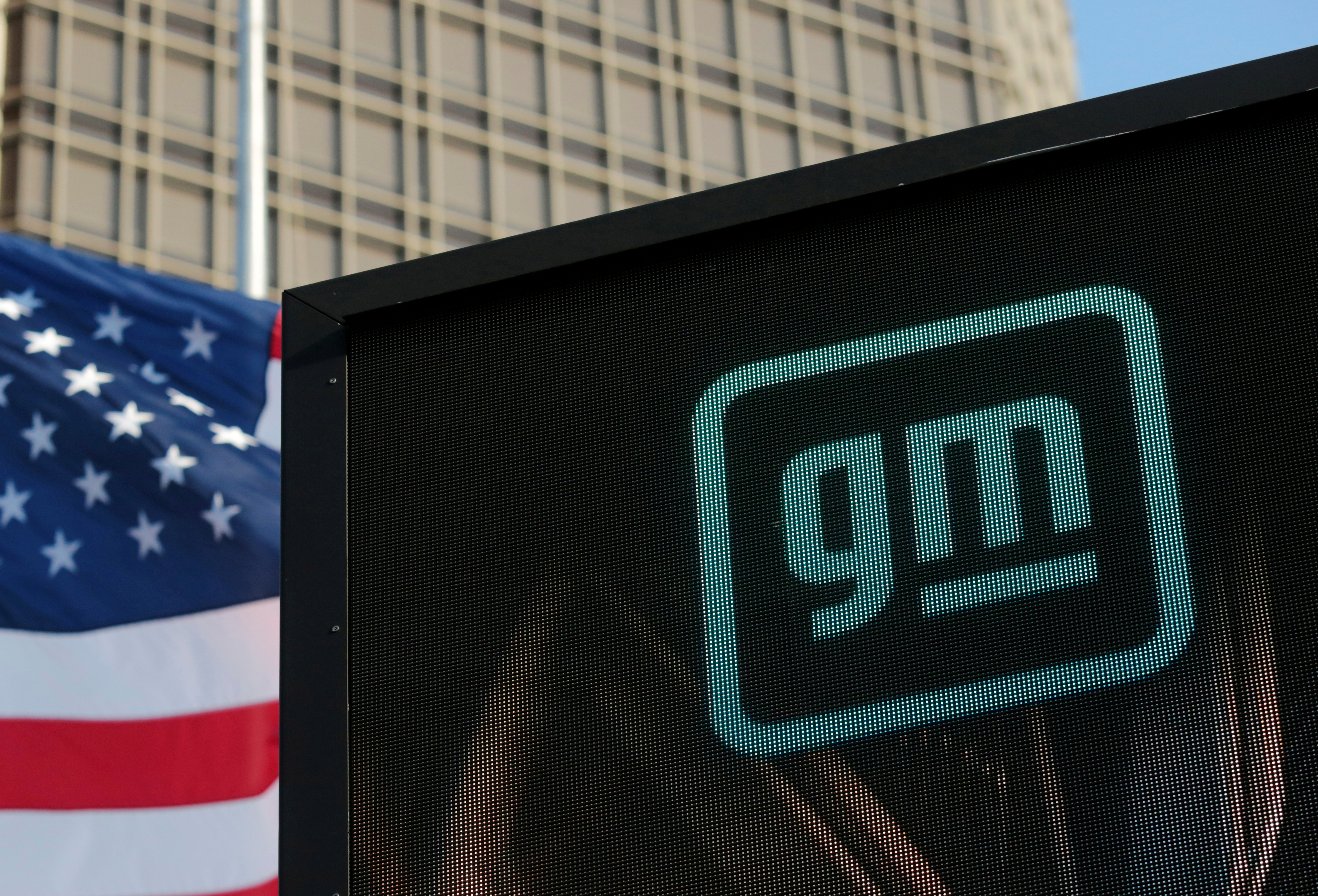 The new GM logo is seen on the facade of the General Motors headquarters in Detroit, Michigan, U.S., March 16, 2021. Picture taken March 16, 2021.  REUTERS/Rebecca Cook/Files