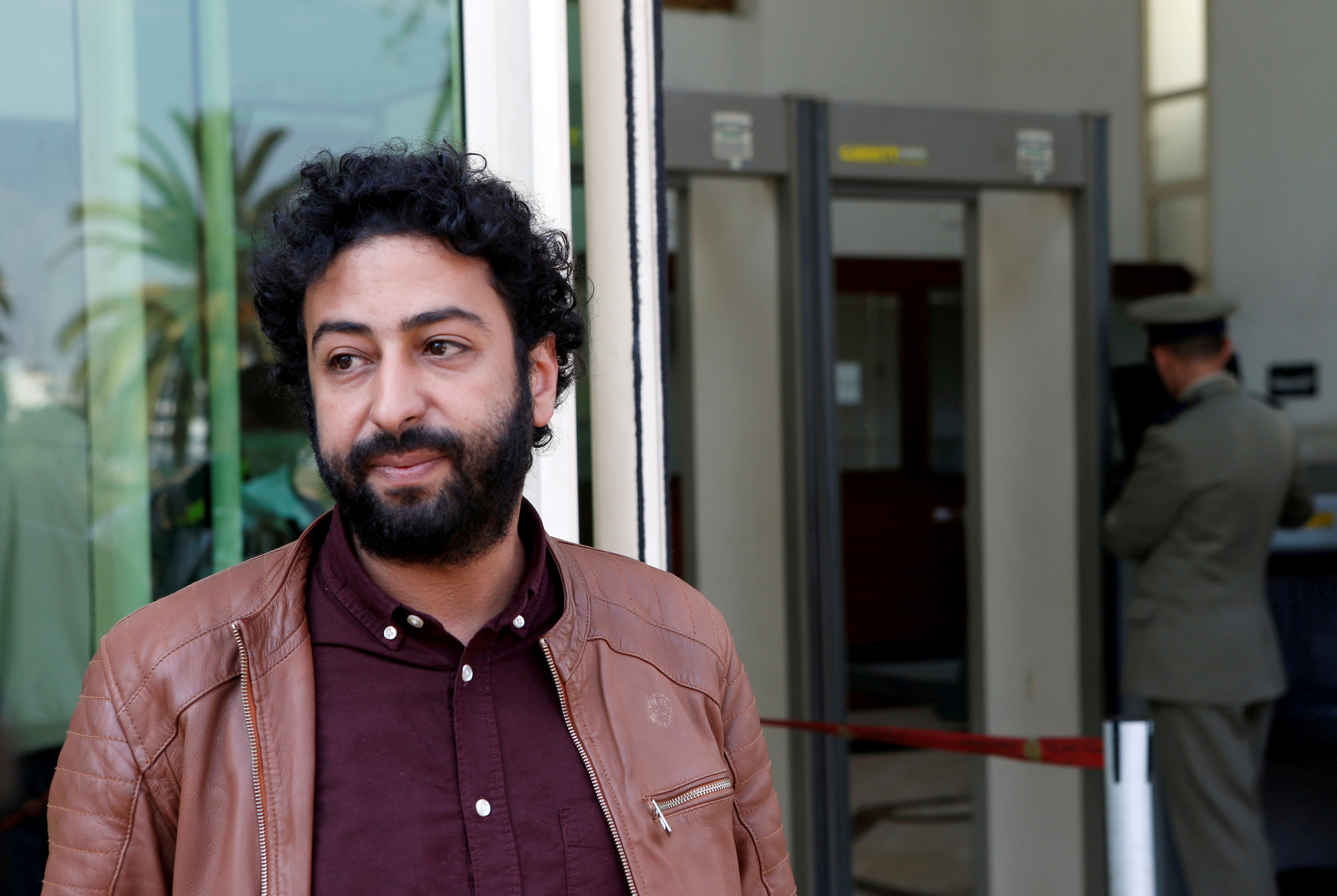 Journalist and activist Omar Radi waits outside court in Casablanca, Morocco March 12, 2020. REUTERS/Youssef Boudlal/File Photo