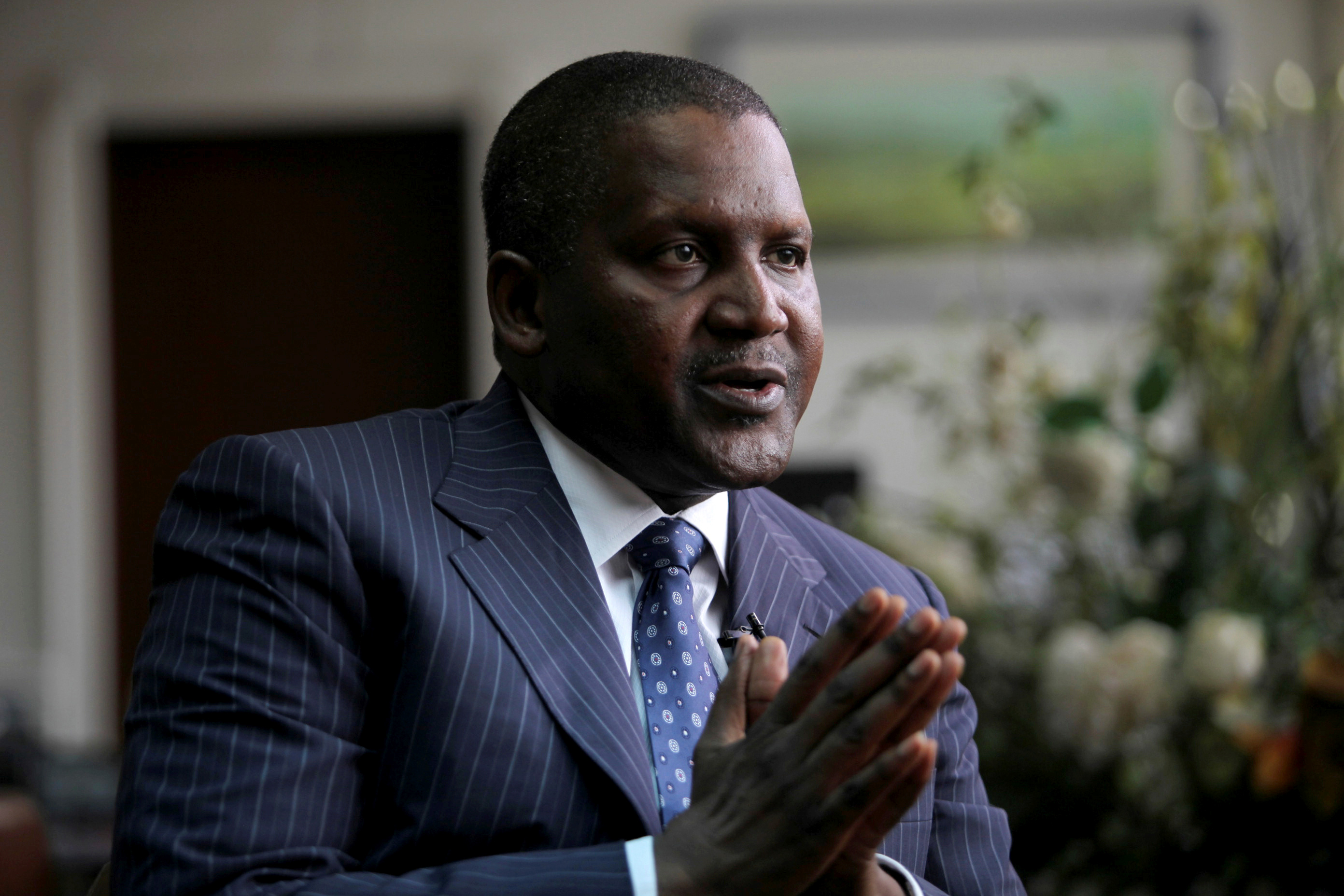 Founder and Chief Executive of the Dangote Group Aliko Dangote gestures during an interview with Reuters in his office in Lagos, Nigeria, file. REUTERS/Akintunde Akinleye/File Photo