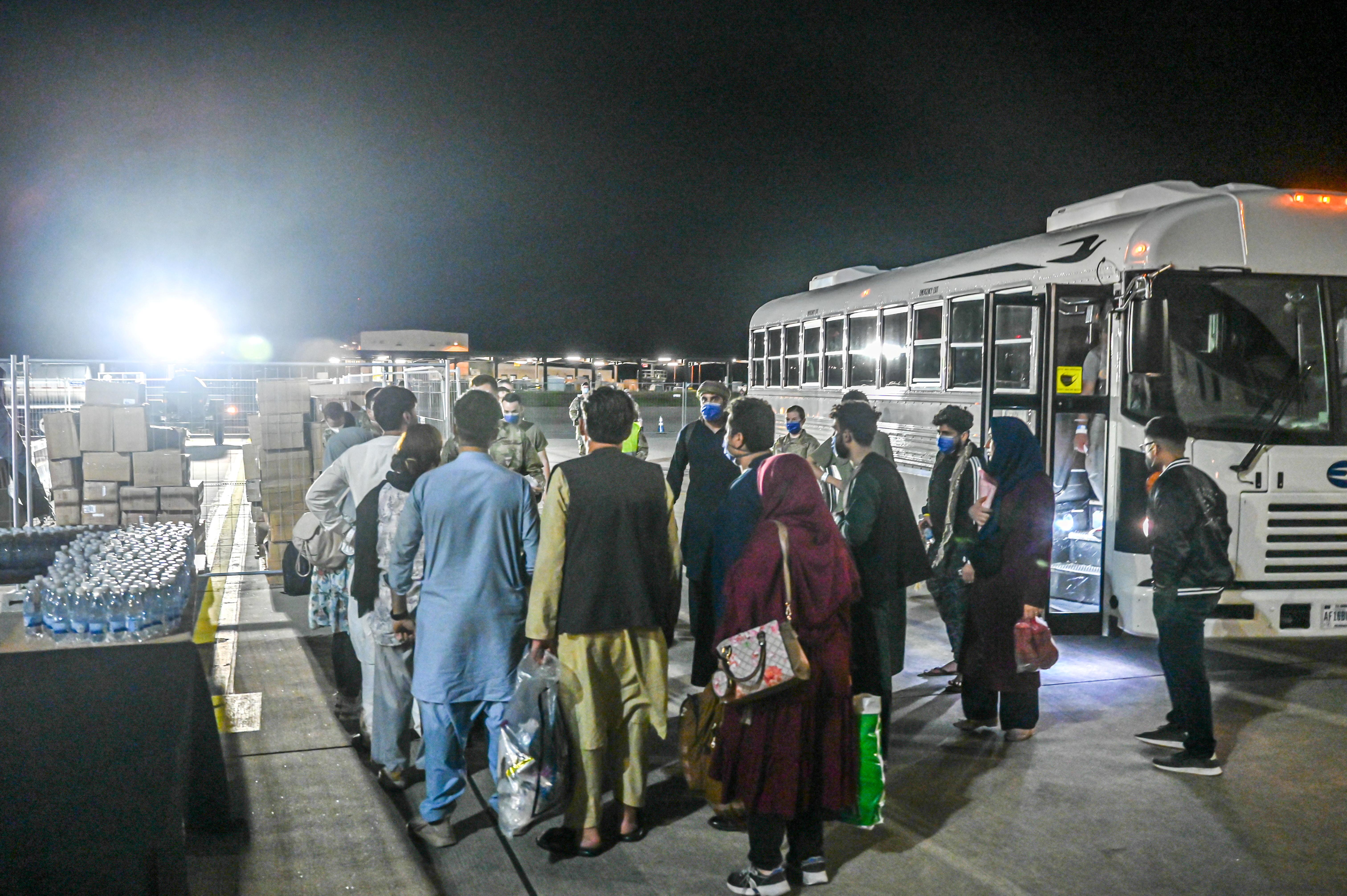A group of evacuees from Afghanistan depart a bus at Ramstein Air Base, Germany, Augusut 20, 2021. U.S. Air Force/Senior Airman Jan K. Valle/Handout via REUTERS