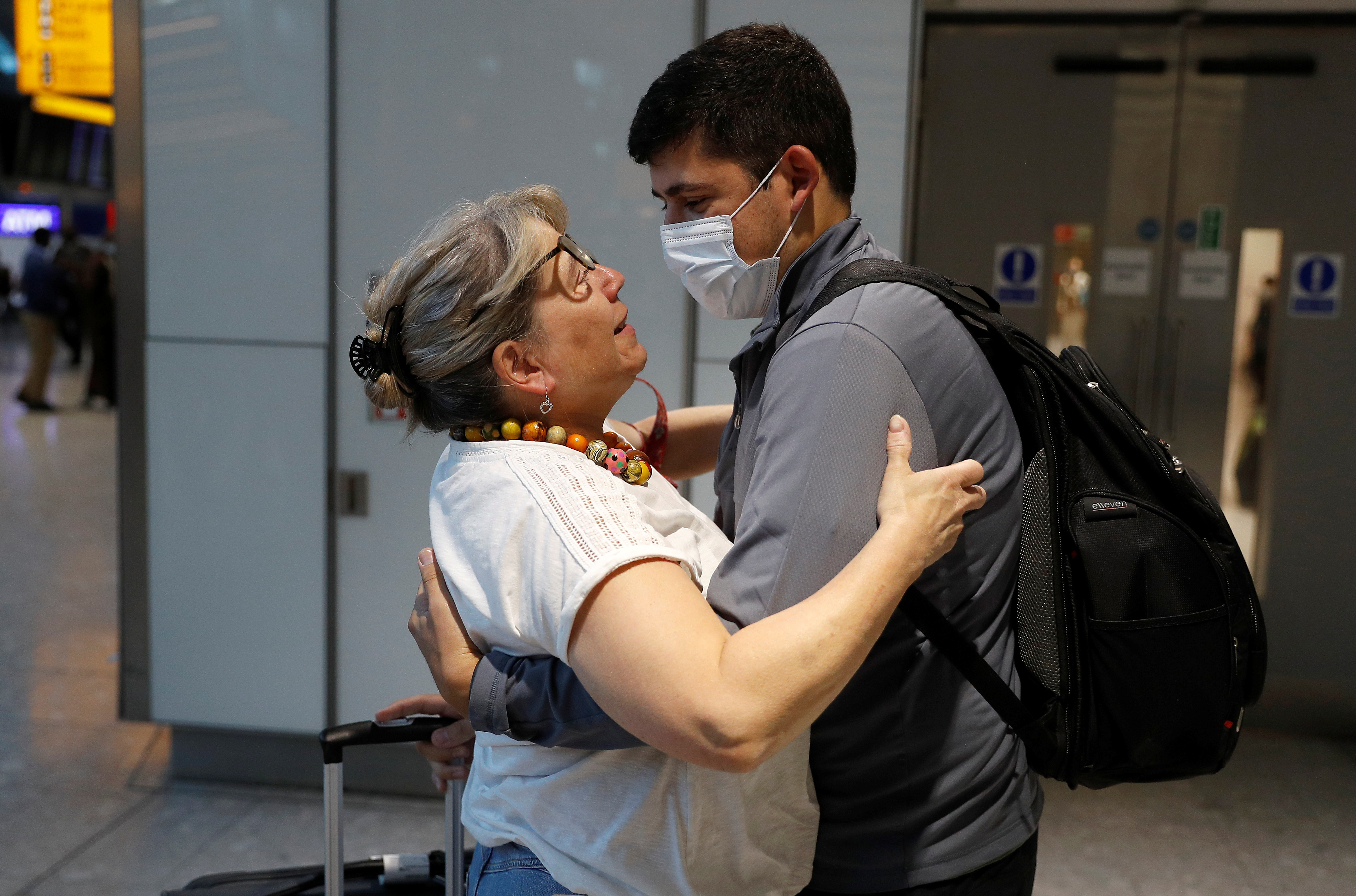 Karen Tyler embraces her son Jonathan who arrived from the U.S., at the International arrivals area of Terminal 5 in London's Heathrow Airport, Britain, August 2, 2021.  REUTERS/Peter Nicholls