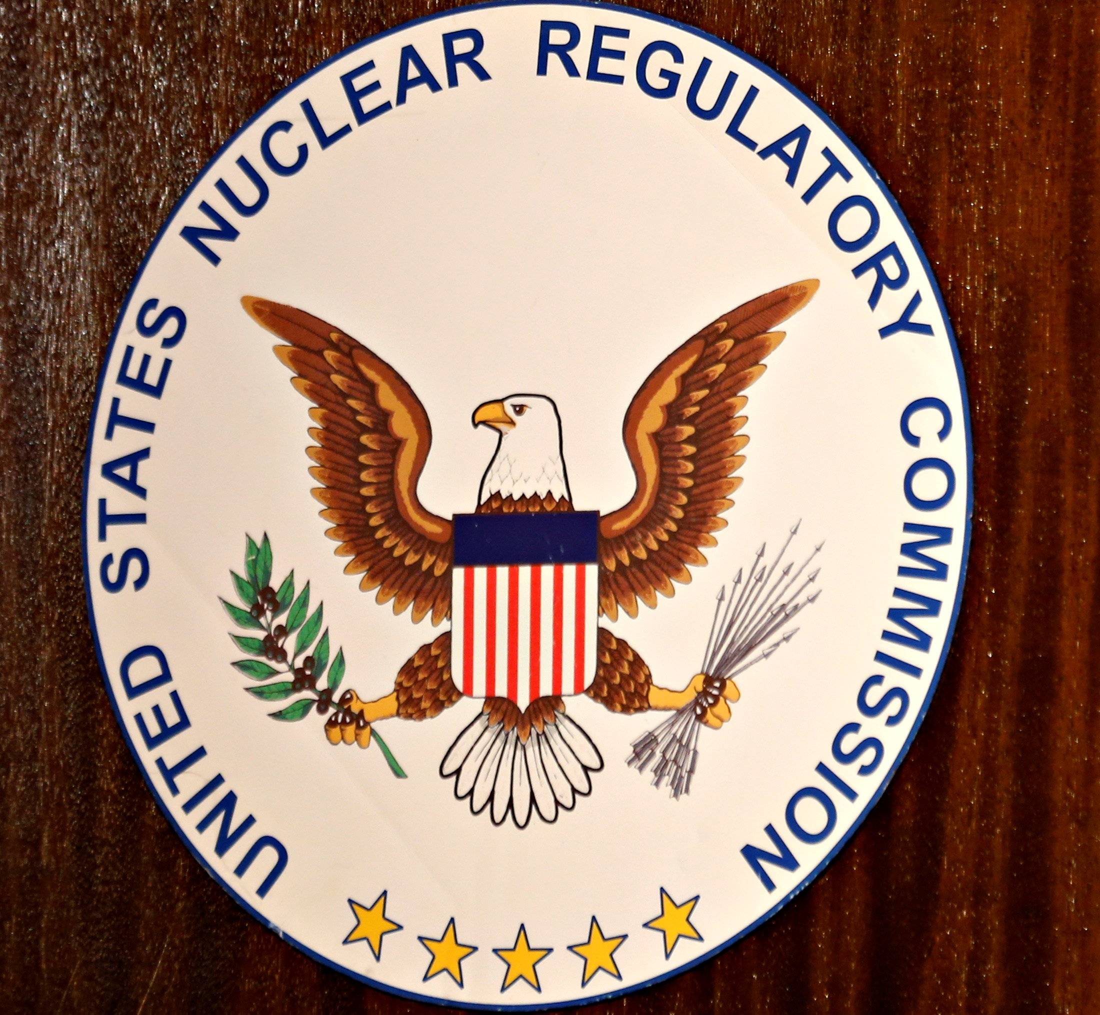 The logo of the U.S. Nuclear Regulatory Commission is shown on the podium during a public meeting hosted by the  U.S. Nuclear Regulatory Commission to discuss issues surrounding the decommissioning of the reactors at the San Onofre Nuclear Generating Station in Carlsbad, California September 26, 2013.  REUTERS/Mike Blake