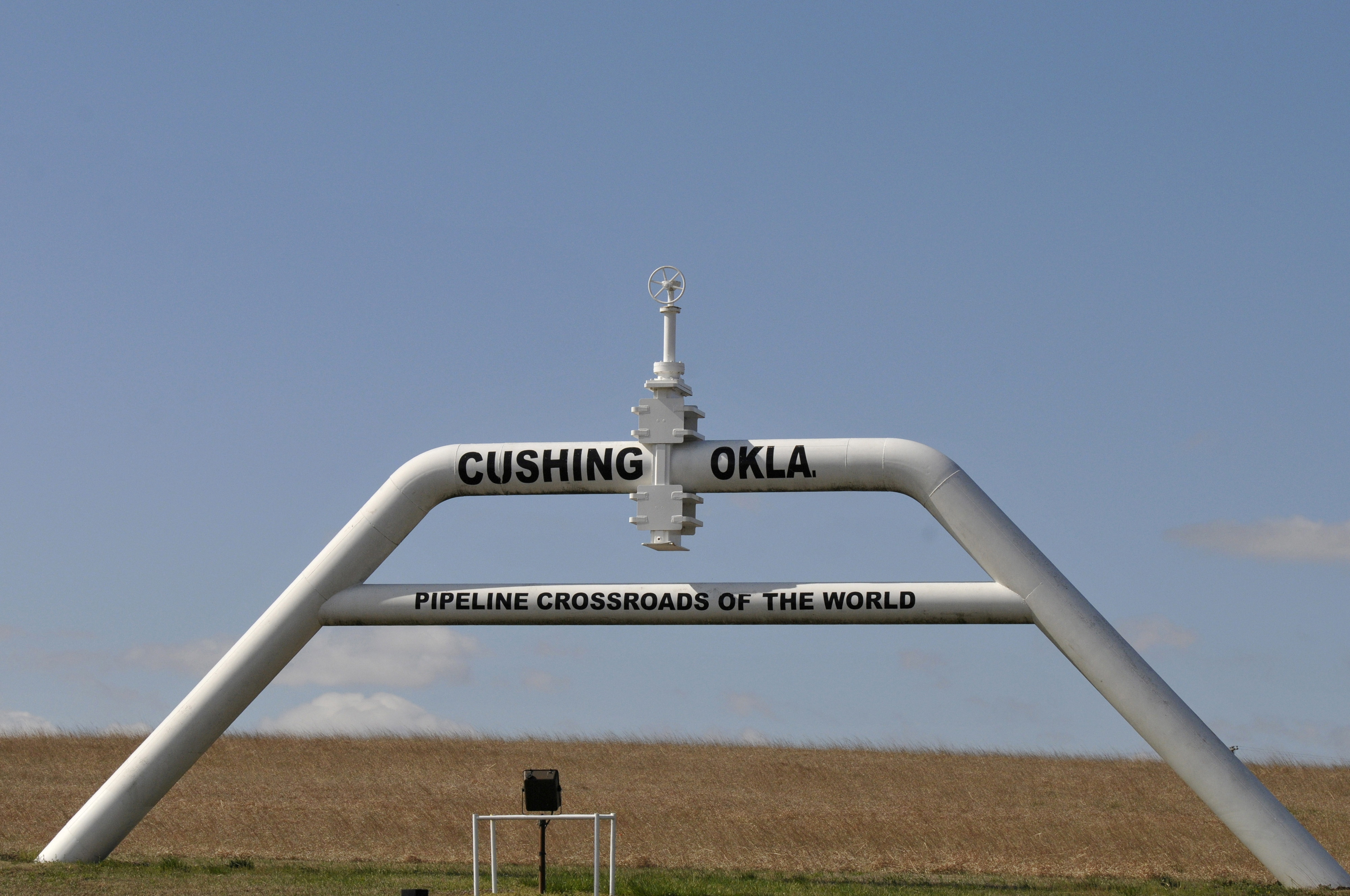 A sign built out of a pipeline that reads