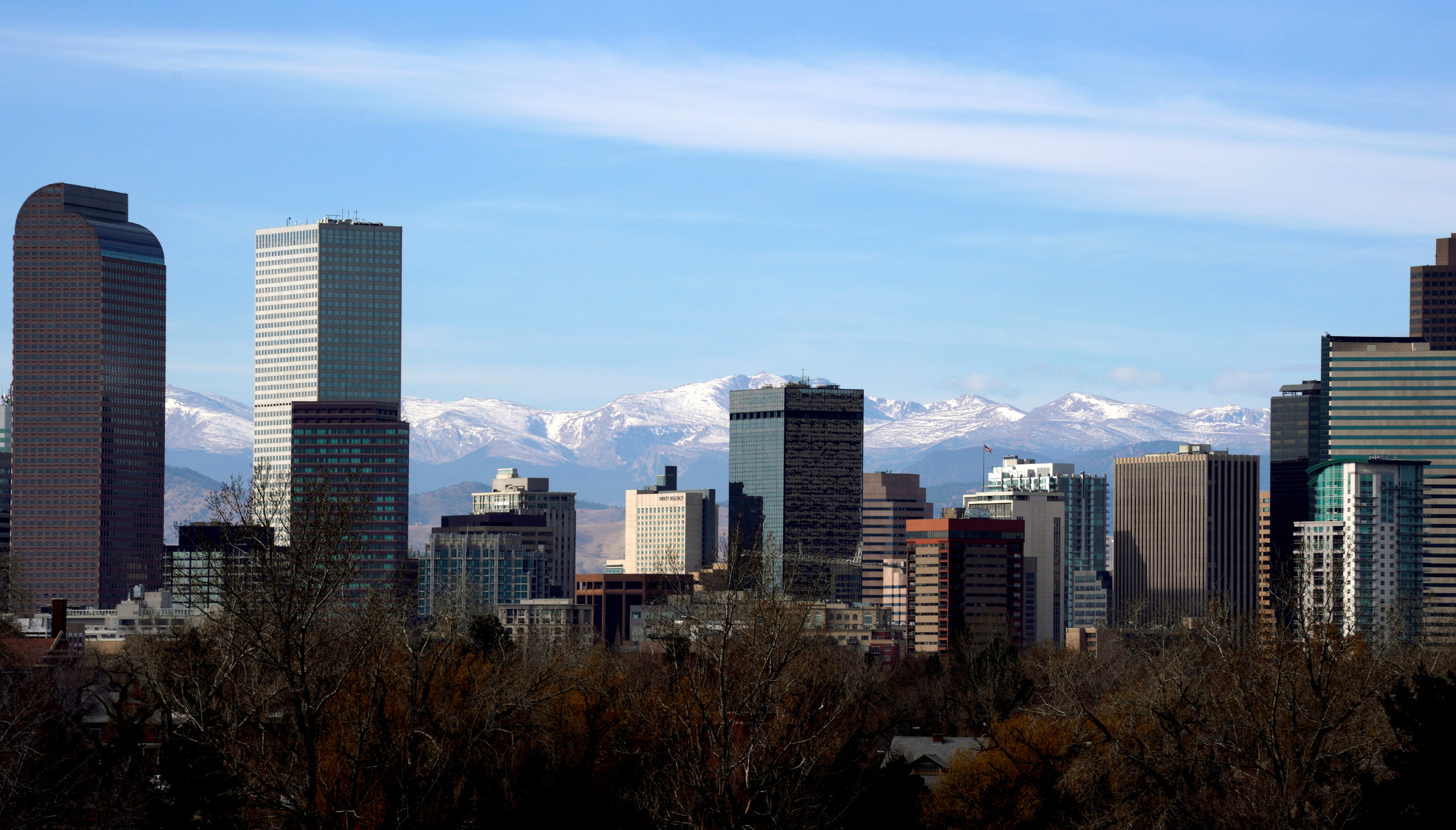 The Continental Divide is seen in the background behind the downtown city skyline in Denver, Colorado, U.S., November 16, 2017. REUTERS/Rick Wilking