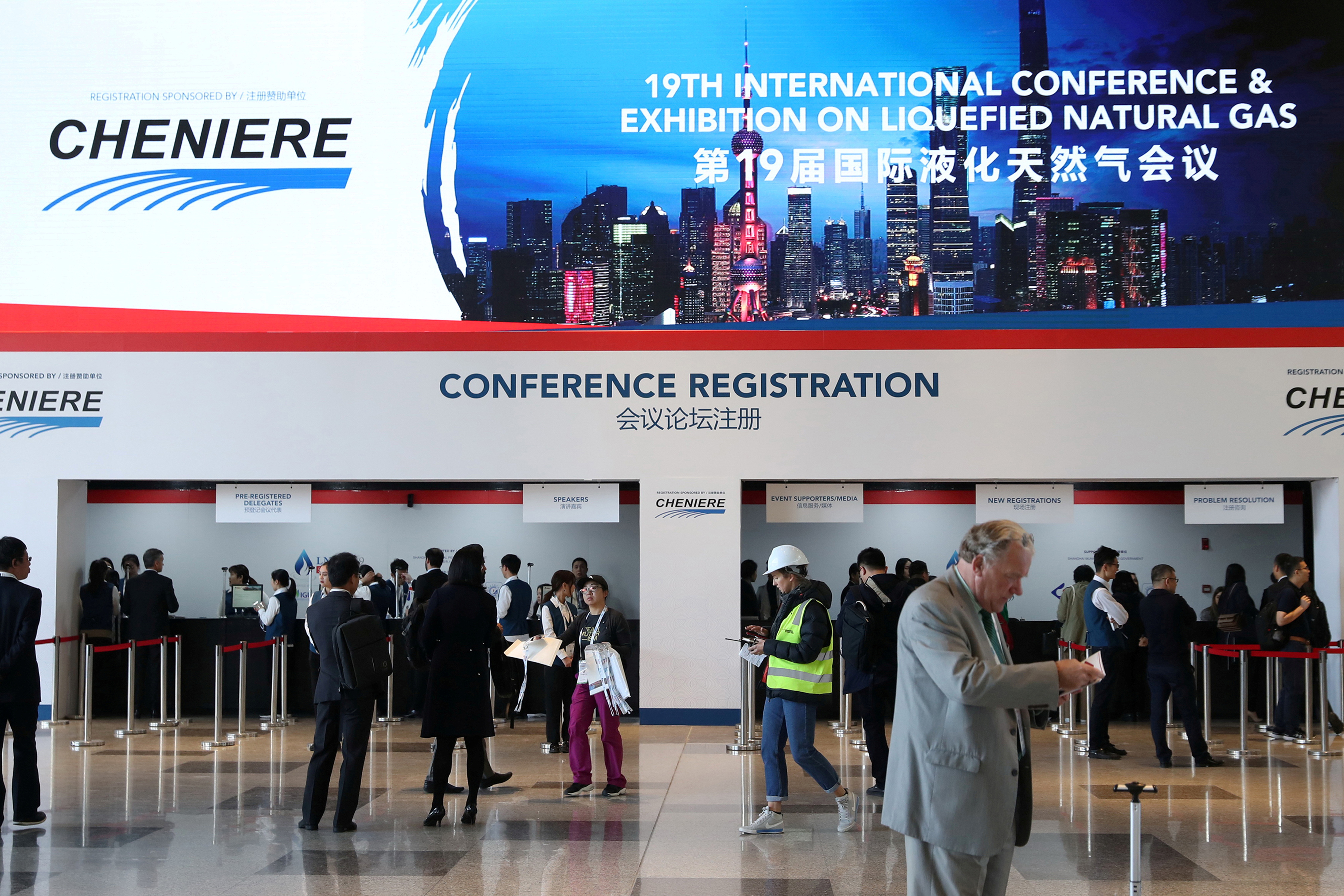 A sign of U.S LNG company Cheniere is seen at the registration counter at the International Conference & Exhibition on Liquefied Natural Gas (LNG2019) in Shanghai, China April 1, 2019. REUTERS/Stringer