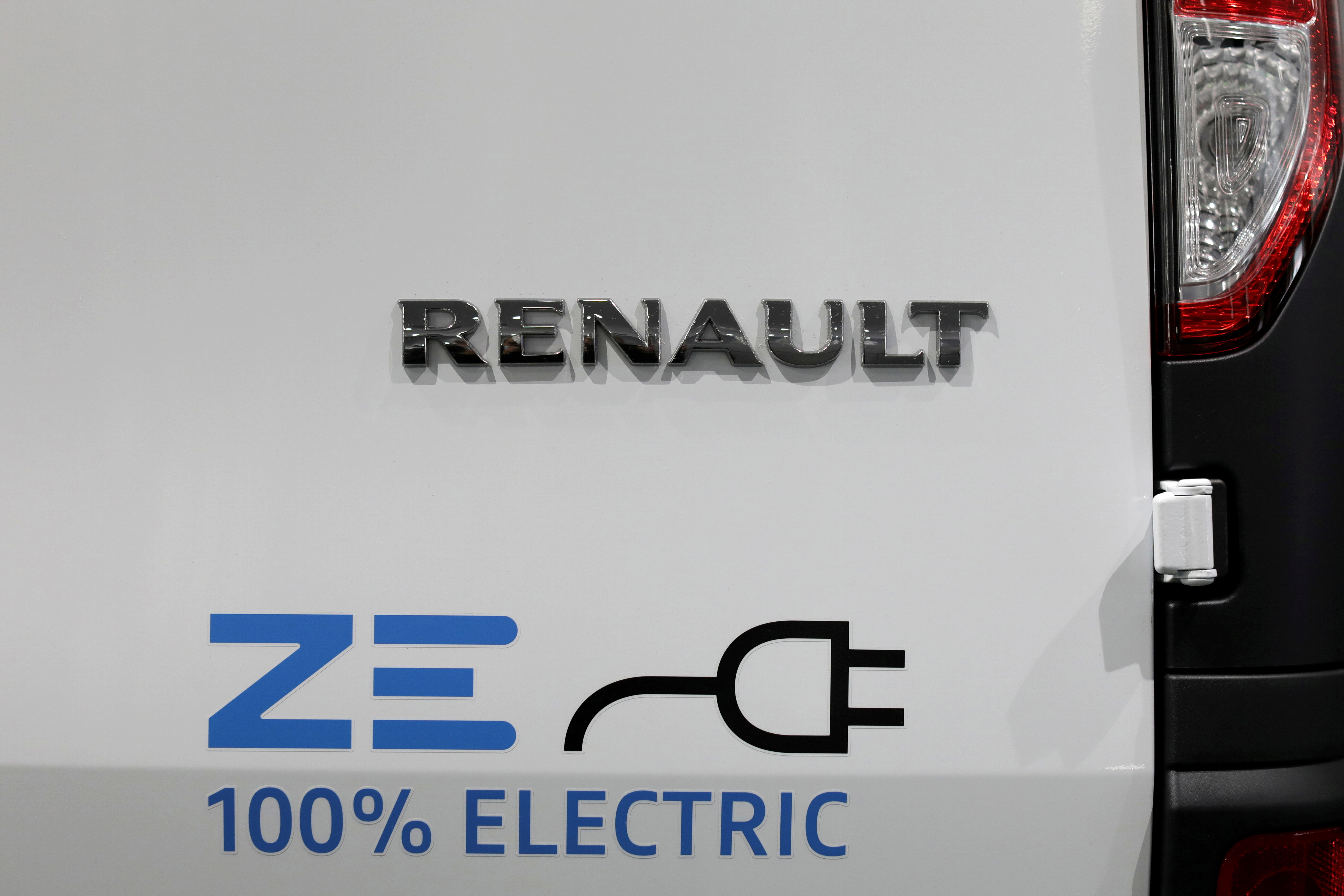 A 100% Electric logo is seen on a Renault Kangoo ZE electric utility vehicle at a Renault automobile dealership in Cagnes-Sur-Mer, France, October 22, 2020. REUTERS/Eric Gaillard/File Photo