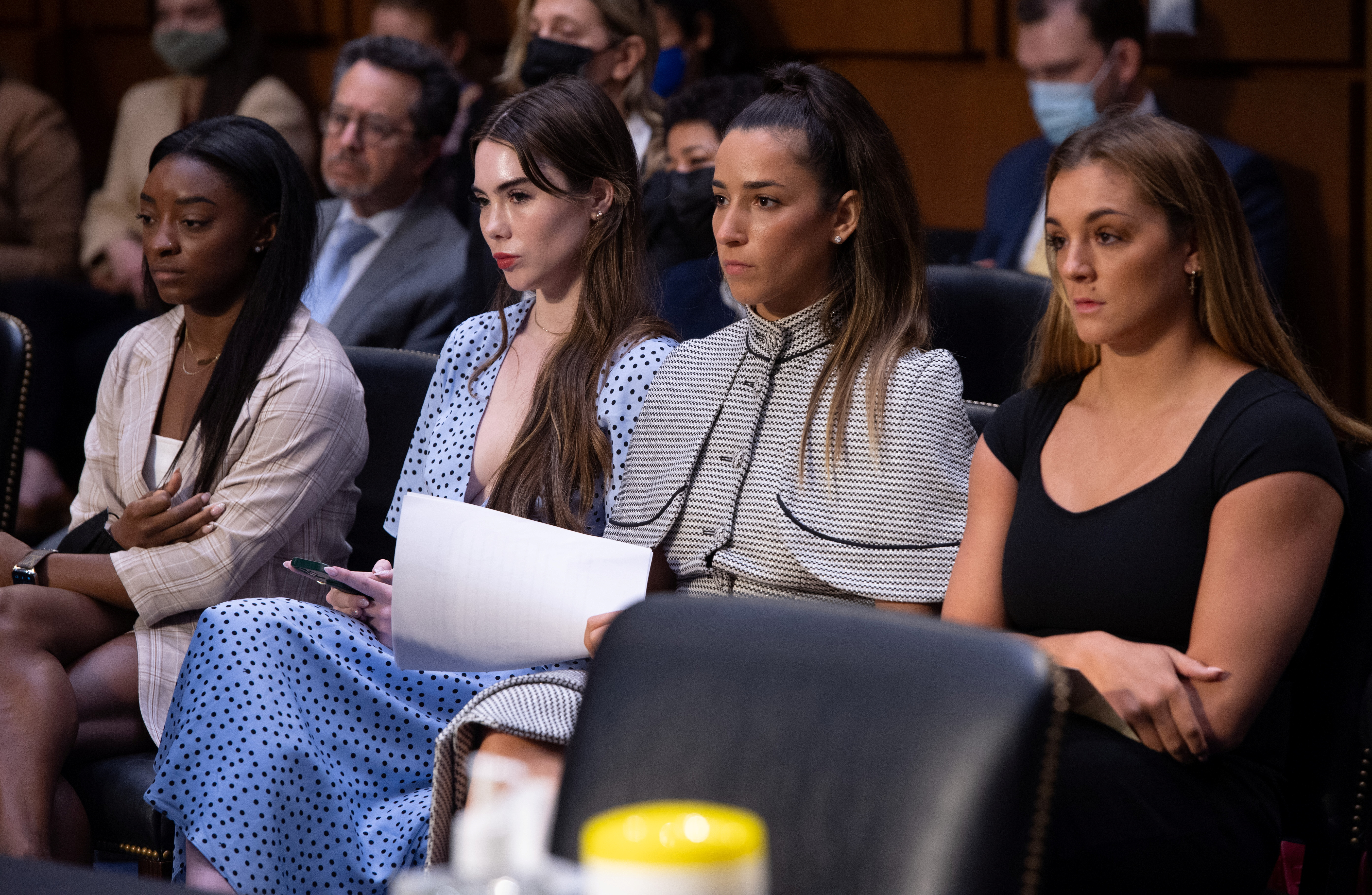 U.S. Olympic gymnasts Simone Biles, McKayla Maroney, Aly Raisman and Maggie Nichols arrive to testify during a Senate Judiciary hearing about the Inspector General's report on the FBI handling of the Larry Nassar investigation of sexual abuse of Olympic gymnasts, on Capitol Hill, in Washington, D.C., U.S., September 15, 2021. Saul Loeb/Pool via REUTERS
