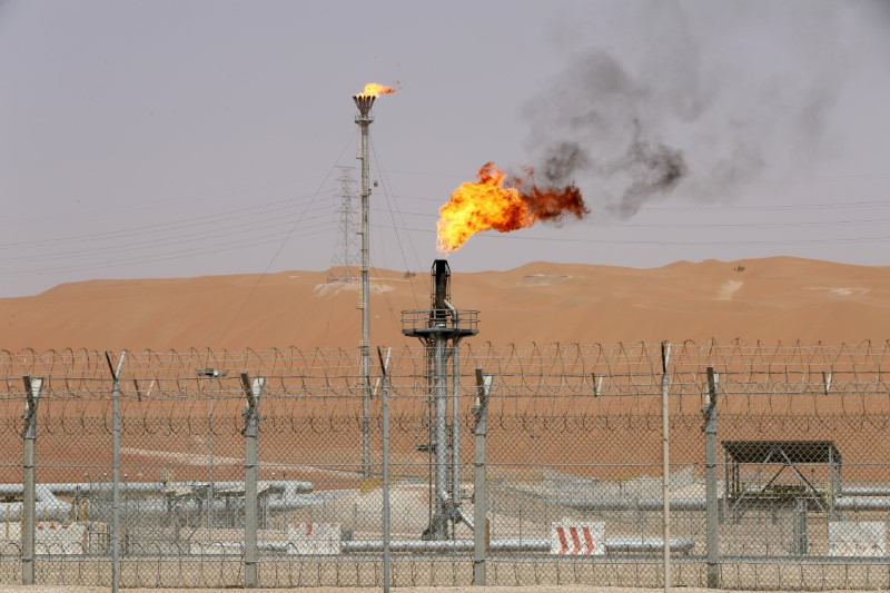 FILE PHOTO: Flames are seen at the production facility of Saudi Aramco's Shaybah oilfield in the Empty Quarter, Saudi Arabia May 22, 2018. REUTERS/Ahmed Jadallah/File Photo
