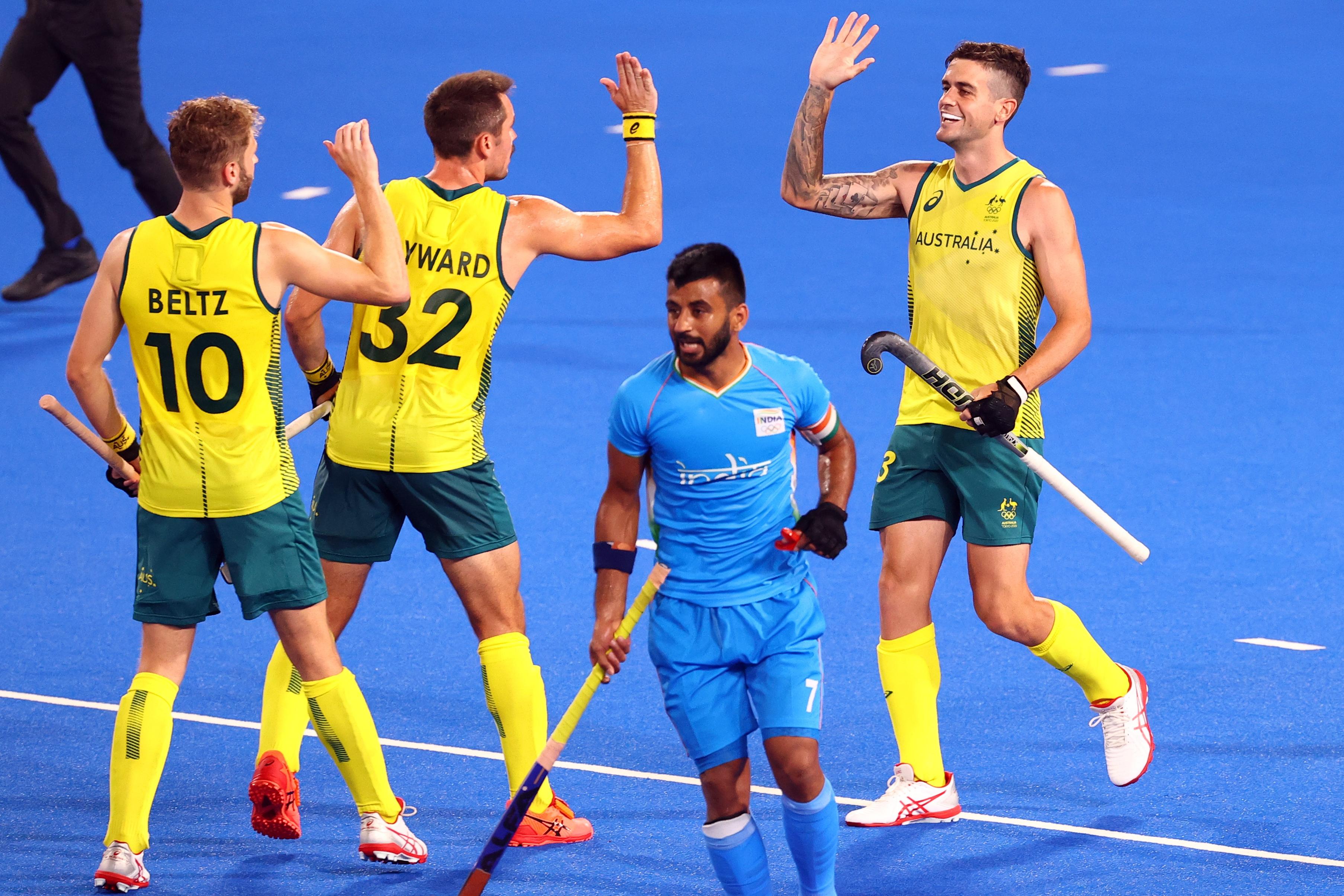 Tokyo 2020 Olympics - Hockey - Men's Pool A - India v Australia - Oi Hockey Stadium, Tokyo, Japan - July 25, 2021.  Players of Australia celebrate their goal. REUTERS/Bernadett Szabo