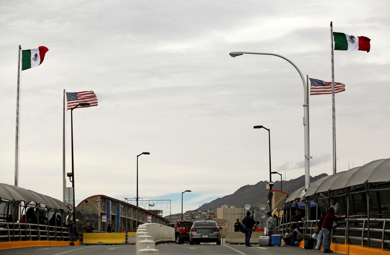 People queue to cross into the U.S. at the Paso del Norte border crossing bridge, as seen from Ciudad Juarez, Mexico March 1, 2020. REUTERS/Jose Luis Gonzalez