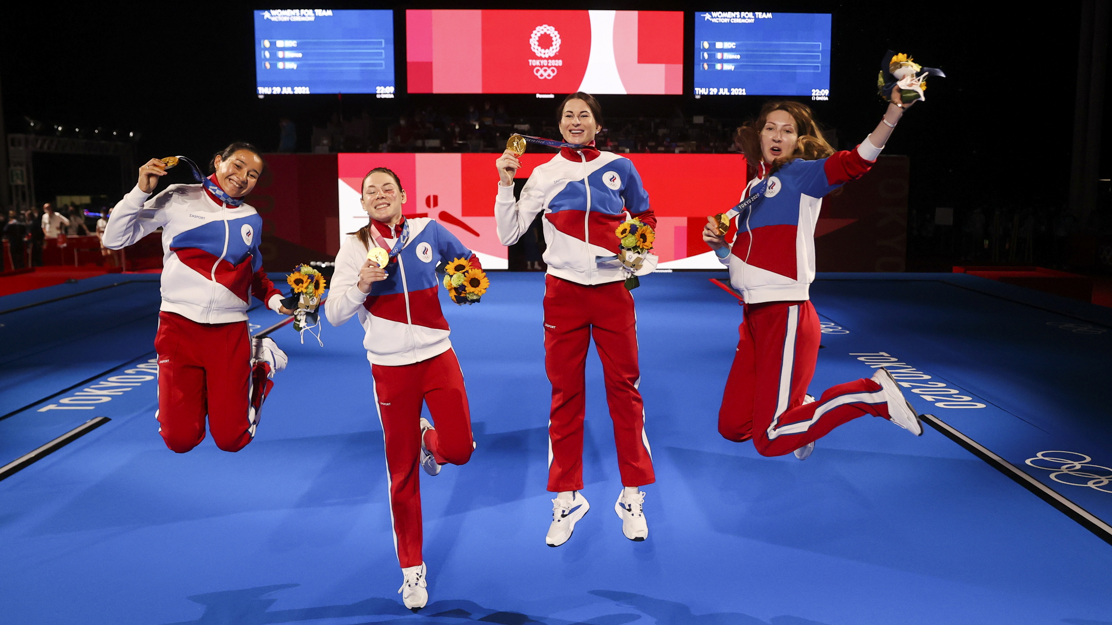 Tokyo 2020 Olympics - Fencing - Women's Team Foil - Medal Ceremony - Makuhari Messe Hall B - Chiba, Japan - July 29, 2021. Gold medallists Inna Deriglazova of the Russian Olympic Committee, Adelina Zagidullina of the Russian Olympic Committee, Larisa Korobeynikova of the Russian Olympic Committee and Marta Martyanova of the Russian Olympic Committee celebrate their victory REUTERS/Carl Recine