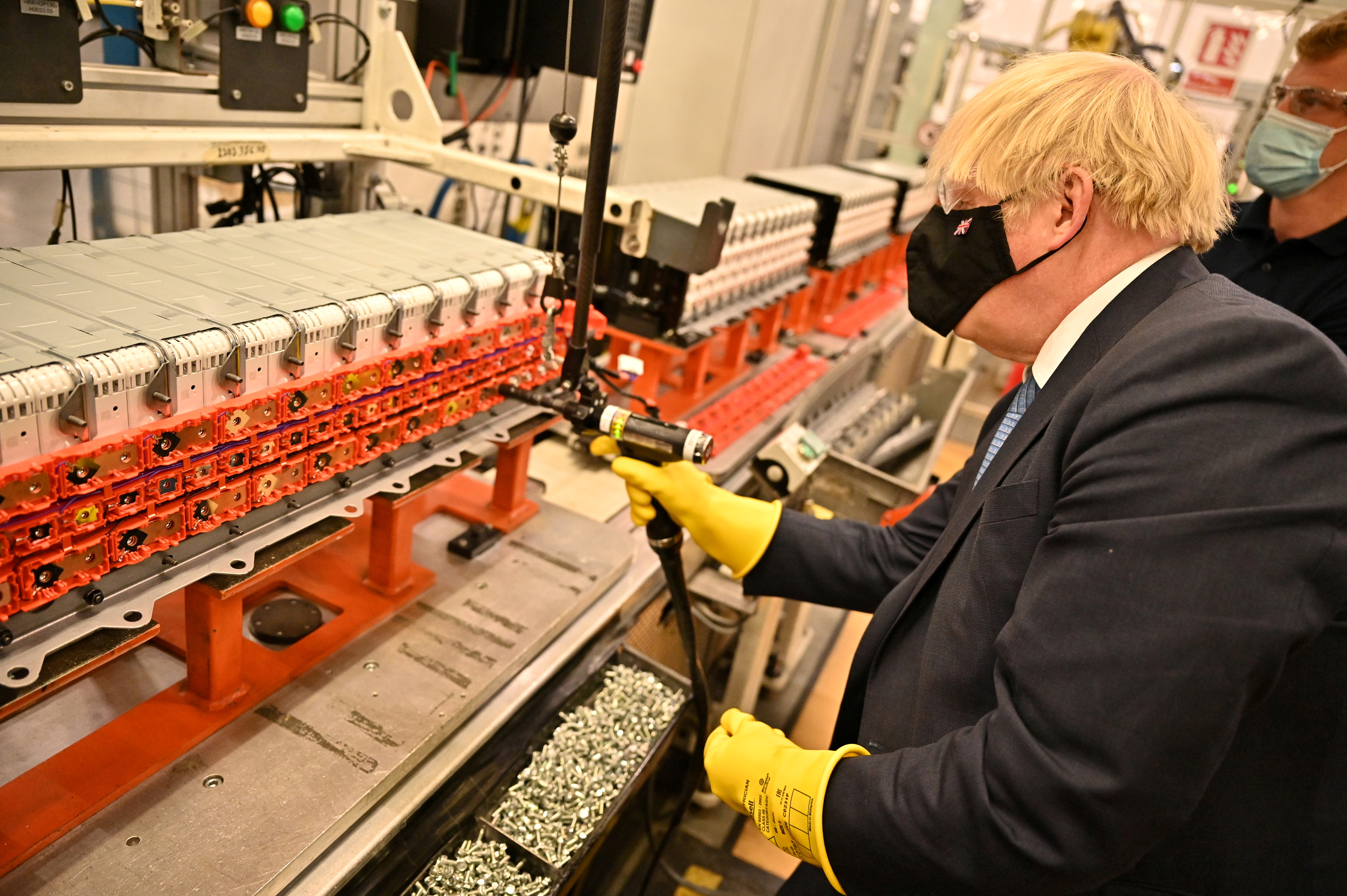 Britain's Prime Minister Boris Johnson visits the Envision AESC Holding Ltd. battery manufacturing facility inside the Nissan Motor Co. plant in Sunderland, Britain July 1, 2021. Jeff J Mitchell/Pool via REUTERS