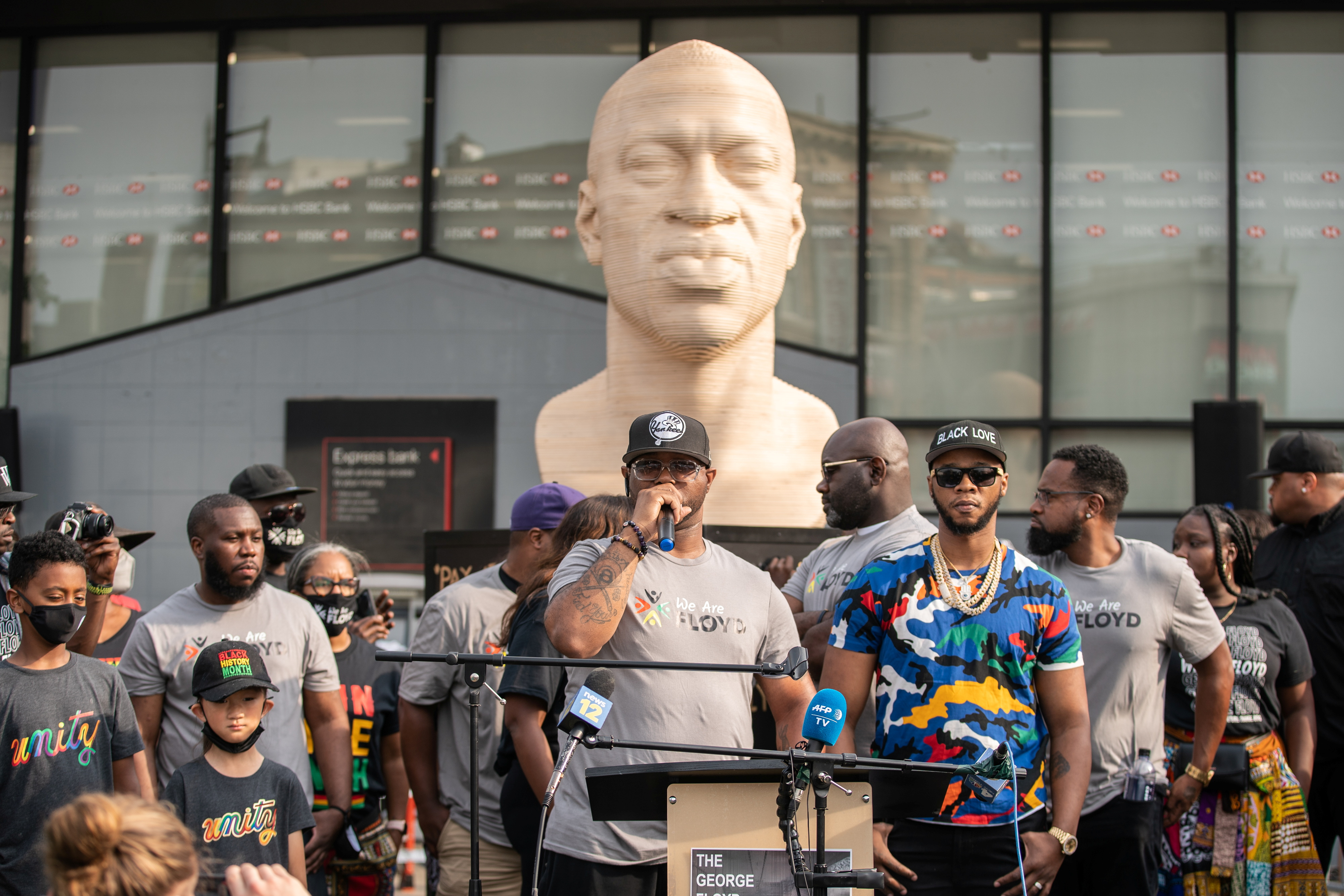 Terrence Floyd, brother of the late George Floyd who was killed by a police officer, speaks during the unveiling event of Floyd's statue, as part of Juneteenth celebrations, in Brooklyn, New York, U.S., June 19, 2021. REUTERS/Jeenah Moon