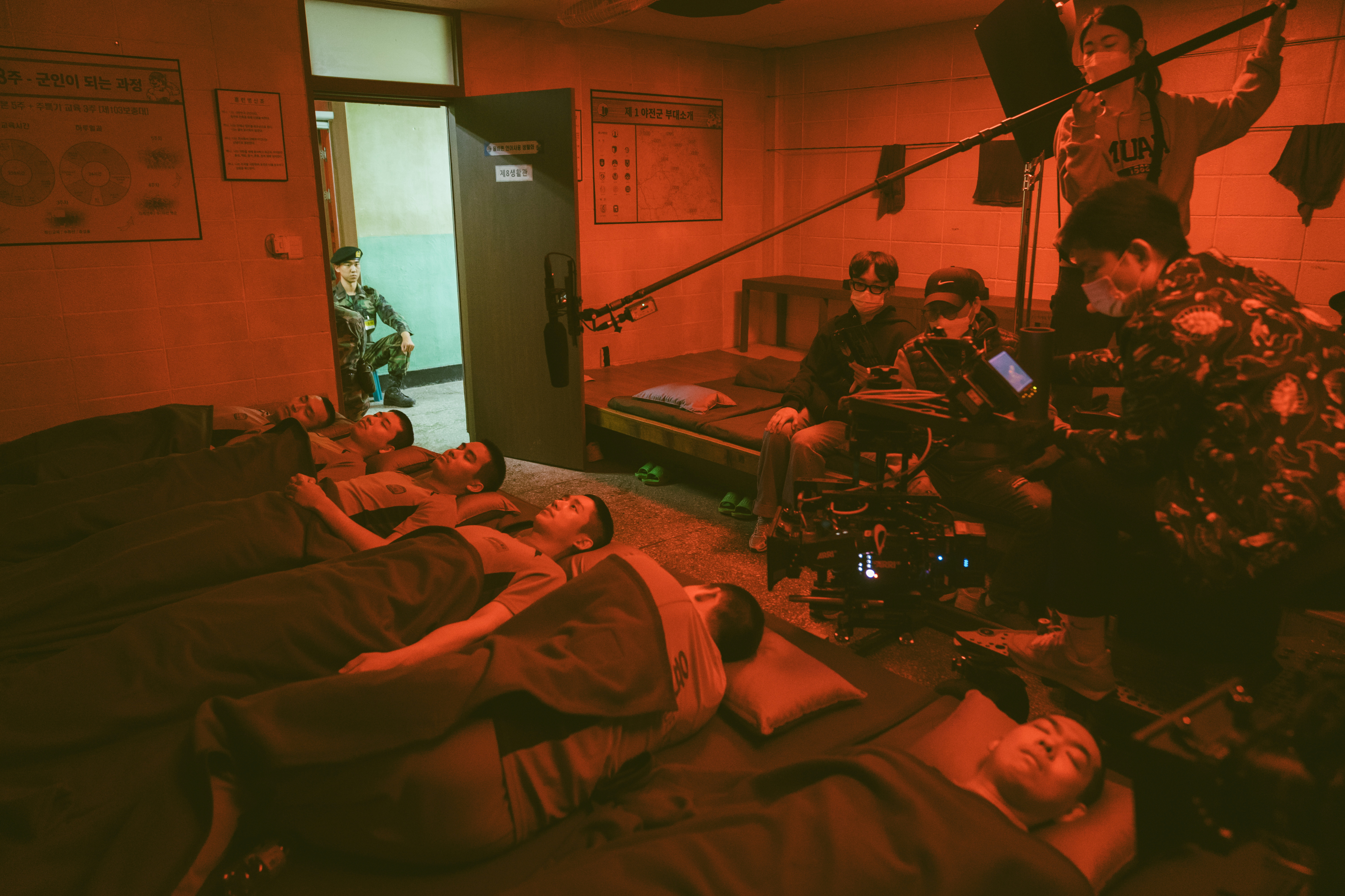 A still image shows a behind the scenes of Netflix series entitled