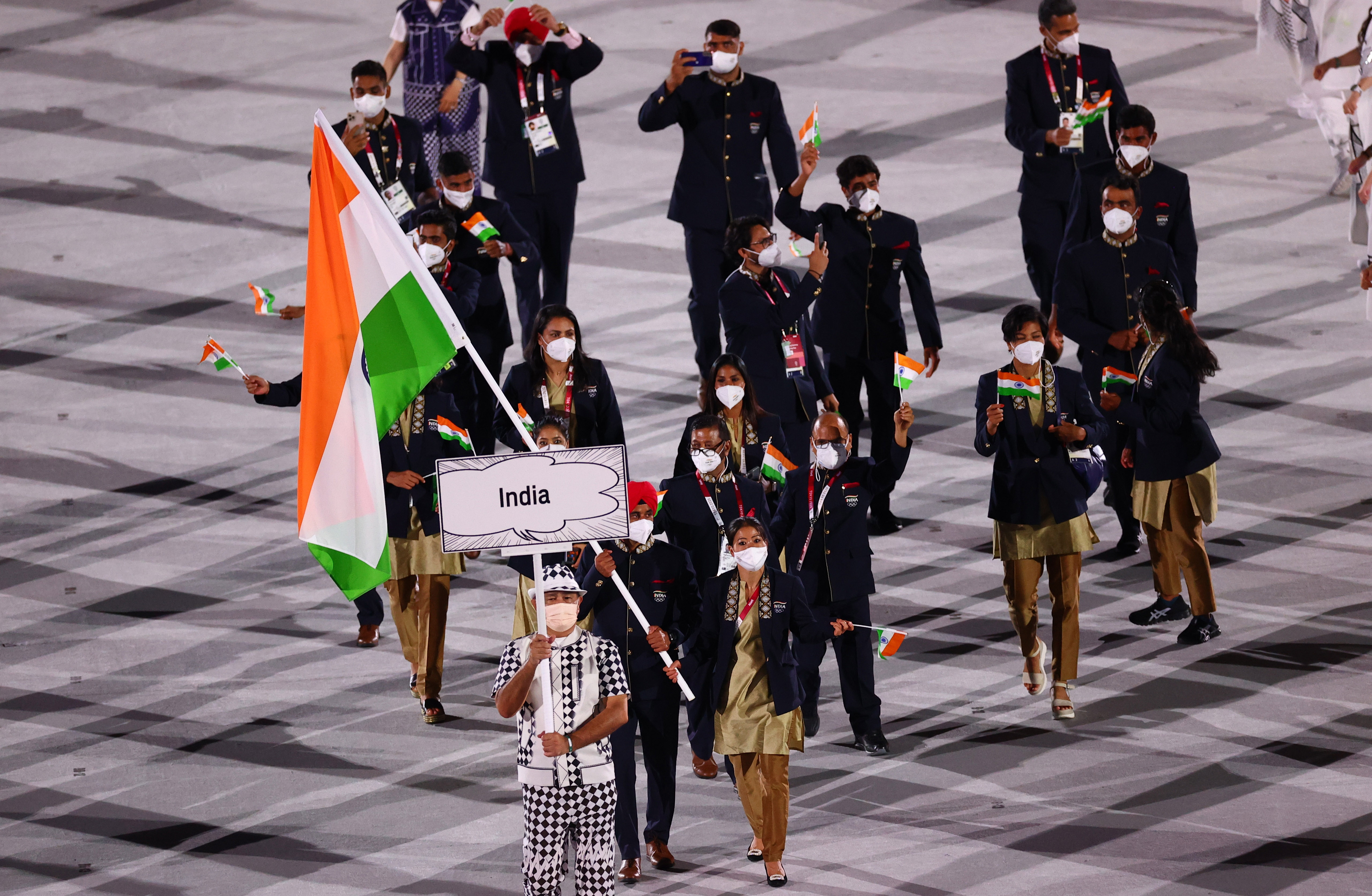 Tokyo 2020 Olympics - The Tokyo 2020 Olympics Opening Ceremony - Olympic Stadium, Tokyo, Japan - July 23, 2021. Mary Kom Hmangte of India and Harmanpreet Singh of India lead their contingent in the athletes parade during the opening ceremony REUTERS/Mike Blake/Files