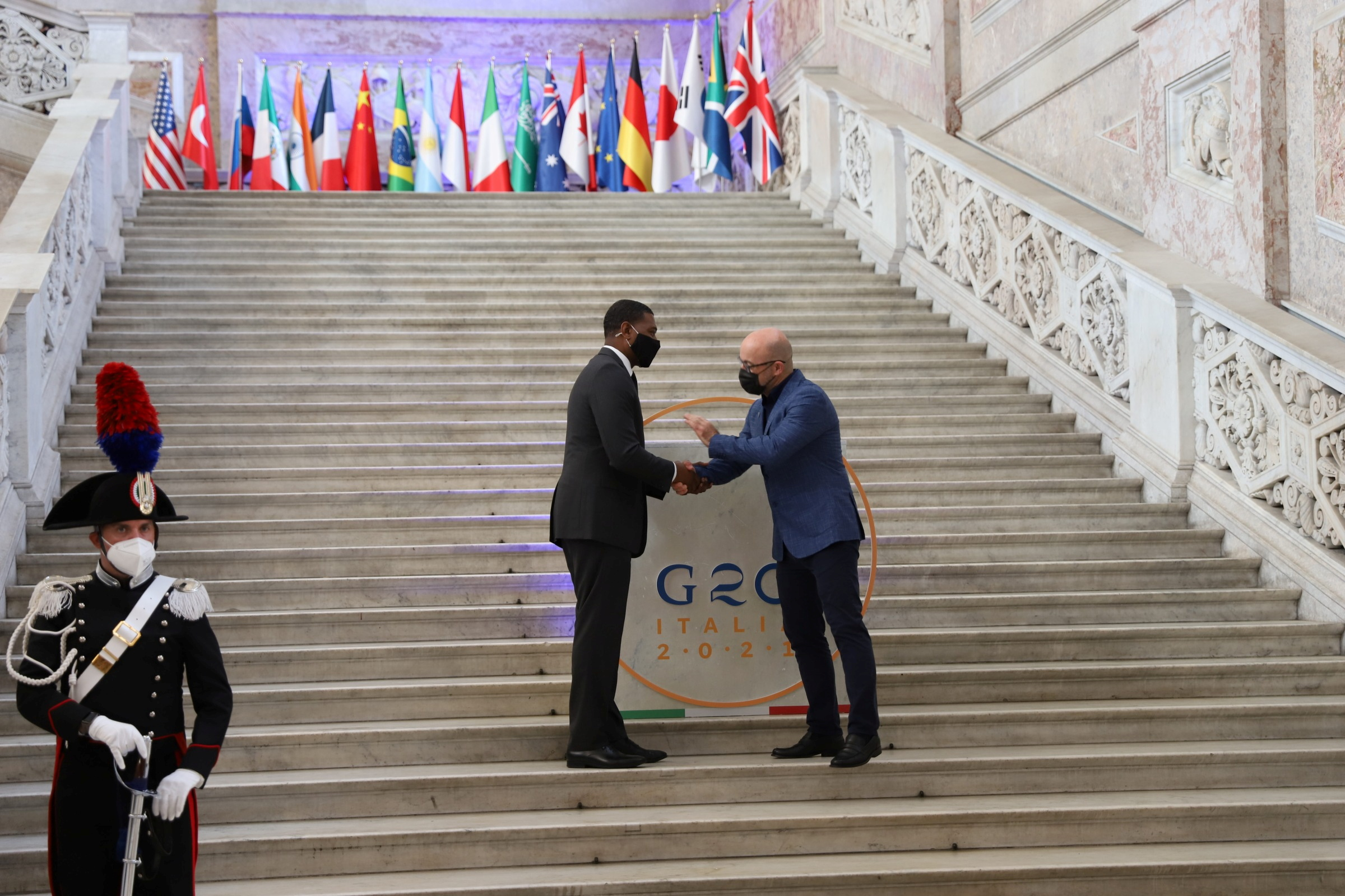 U.S. Environmental Protection Agency Administrator Michael Regan is greeted by Italy's Ecological Transition Minister Roberto Cingolani at the start of the G20 Environment, Climate and Energy Ministers' Meeting in Naples, Italy, July 22, 2021. G20Italy/Handout via REUTERS