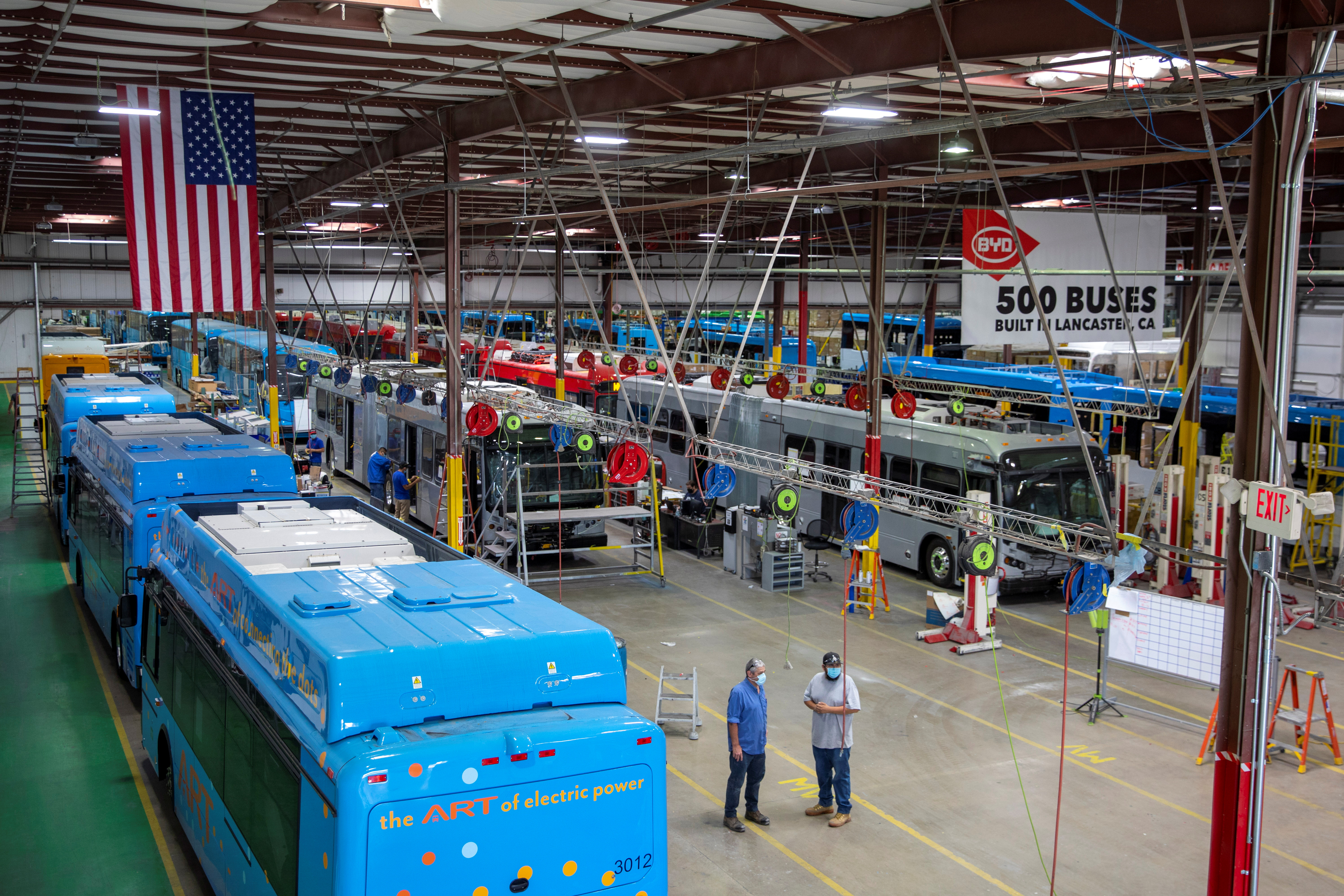 Buses are shown being built at the BYD electric bus factory in Lancaster, California, U.S., July 1, 2021. REUTERS/Mike Blake