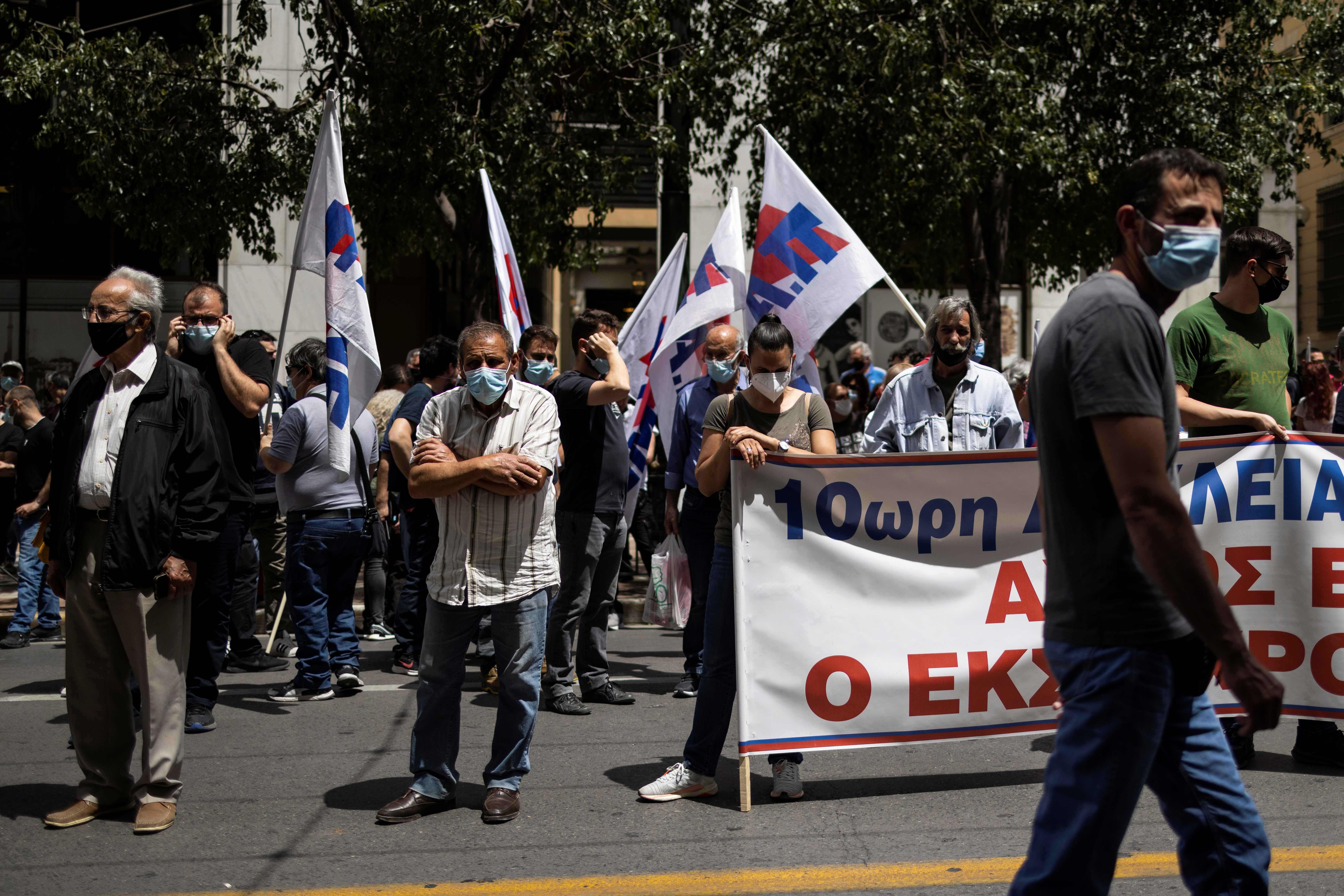 Members of the communist-affiliated trade union PAME demonstrate outside the Labour Ministry against a planned labour bill in Athens, Greece, May 12, 2021. REUTERS/Alkis Konstantinidis