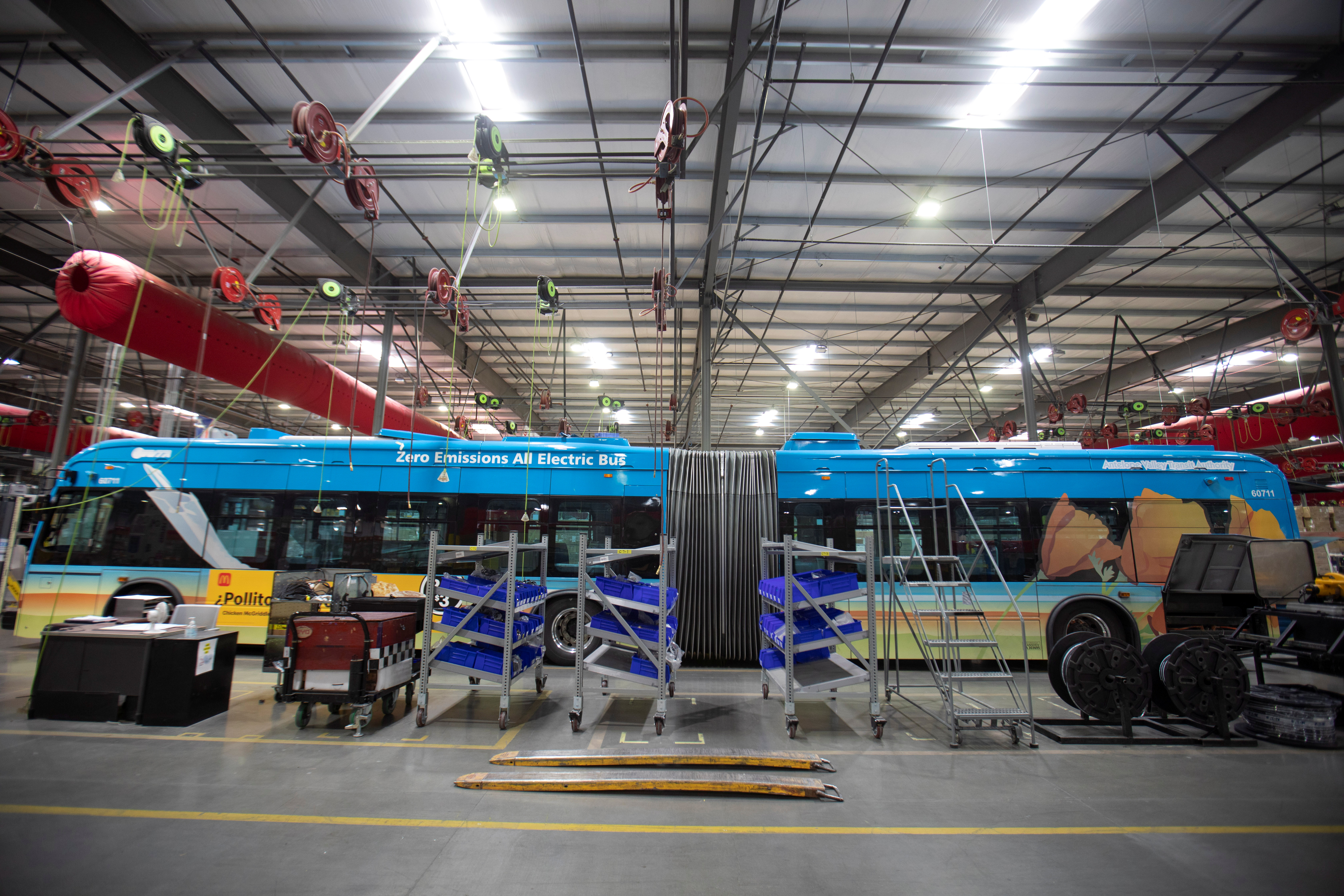 Buses are shown being built at the BYD electric bus factory in Lancaster, California, U.S., July 1, 2021. Picture taken July 1, 2021.   REUTERS/Mike Blake