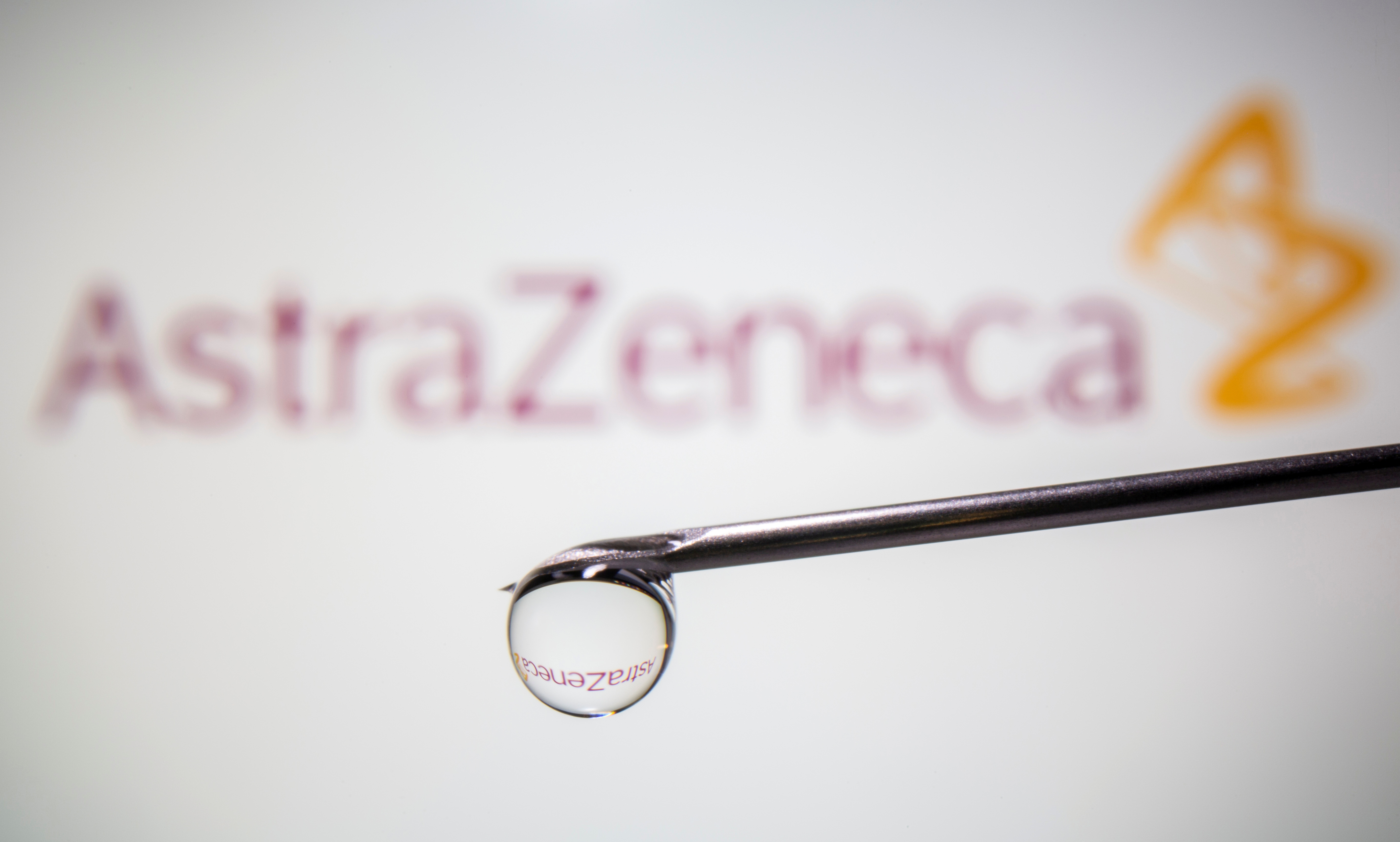 AstraZeneca's logo is reflected in a drop on a syringe needle in this illustration taken November 9, 2020. REUTERS/Dado Ruvic/Illustration/File Photo