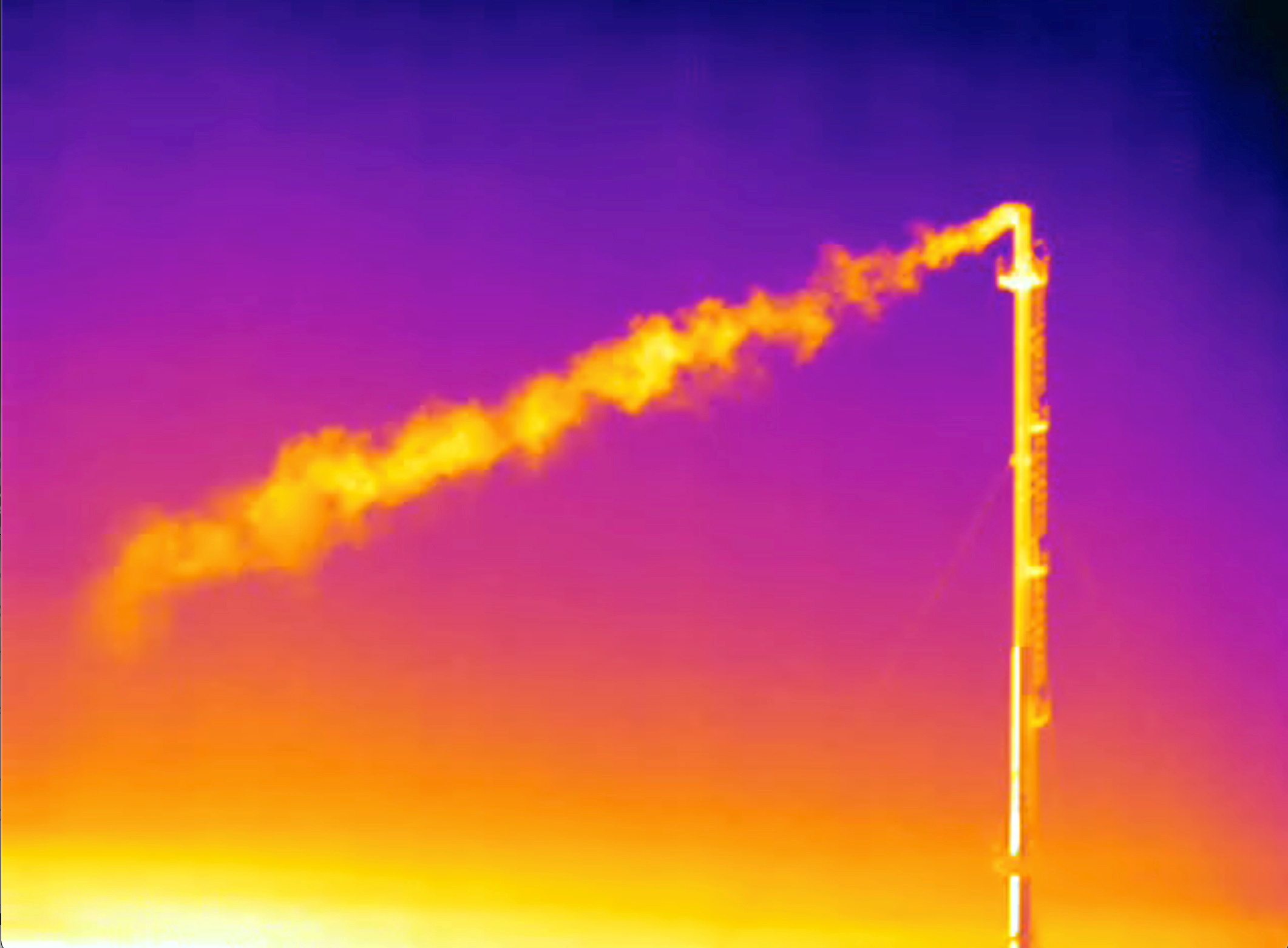 A handout screen grab from thermographic video footage shot with an infrared camera and made available to Reuters June 10, 2021 by Clean Air Task Force (CATF), shows what appears to be a plume of methane gas flowing from a vent stack at the SNAM underground storage facility in Minerbio, Italy. CATF/James Turitto/Handout via Reuters