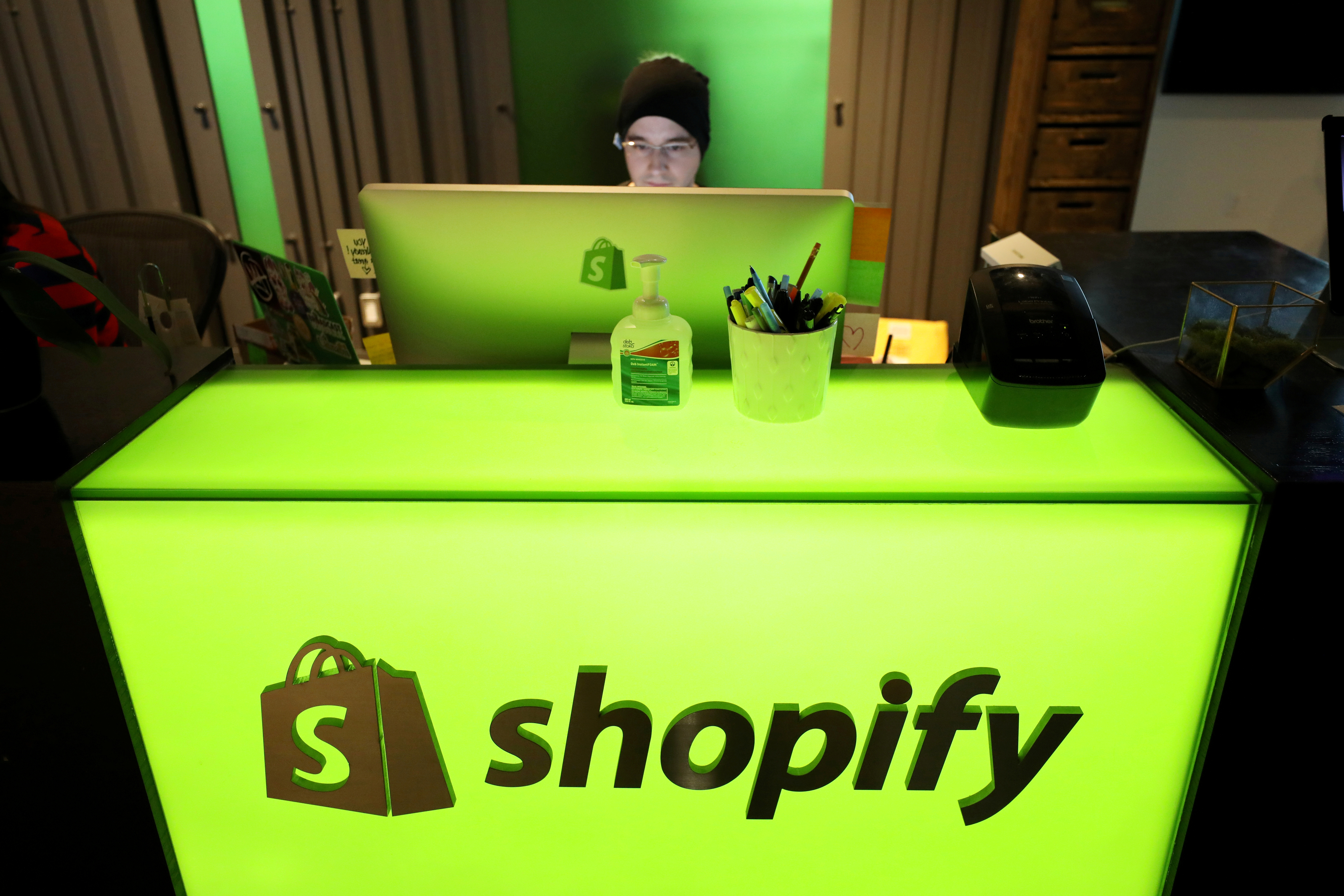 An employee works at Shopify's headquarters in Ottawa, Ontario, Canada, October 22, 2018. REUTERS/Chris Wattie