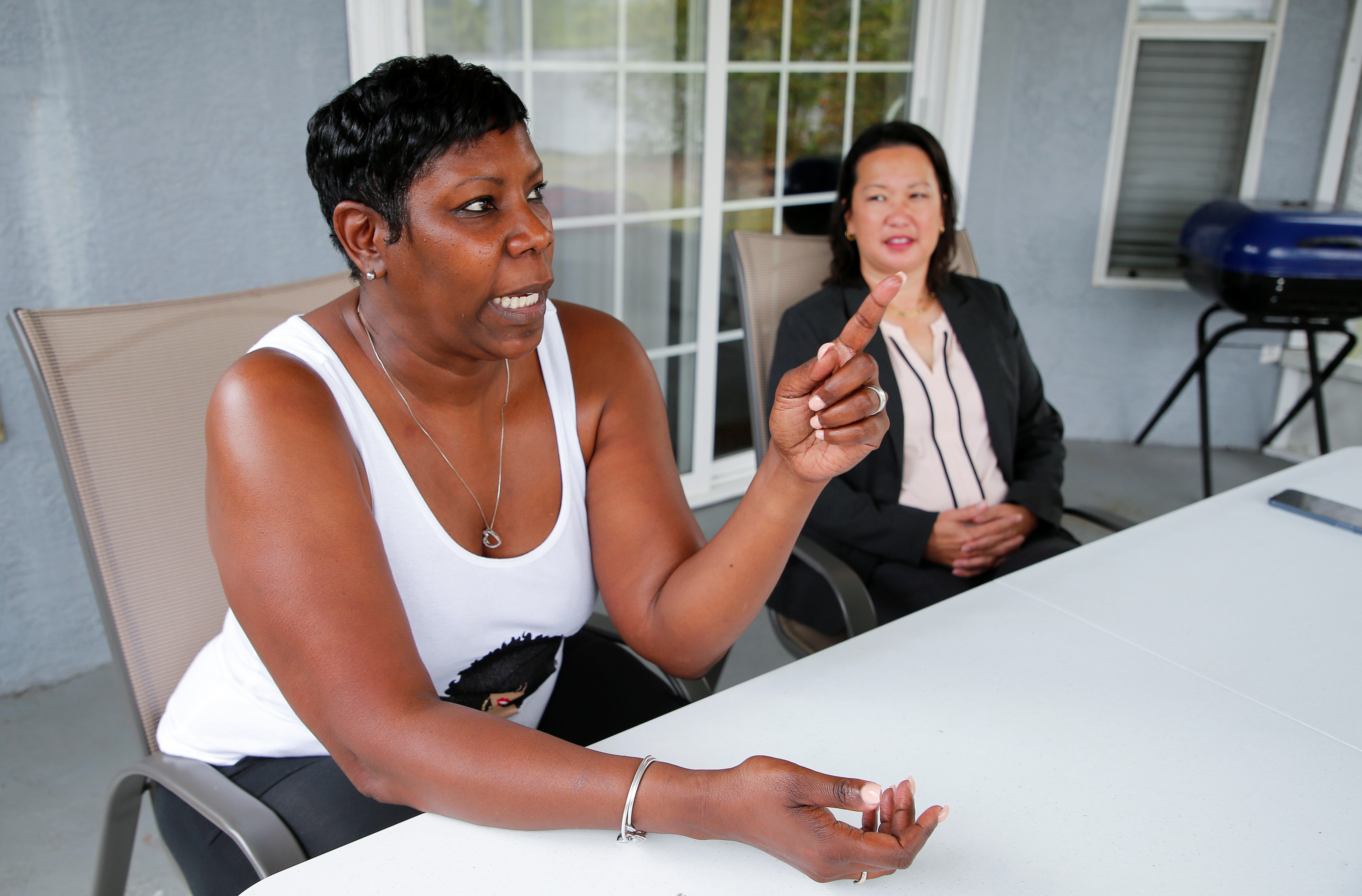 Lichelle Reynolds speaks with Reuters with her attorney Allegra Fung at her home in Riverview, Florida, U.S., March 29, 2021. REUTERS/Joe Skipper