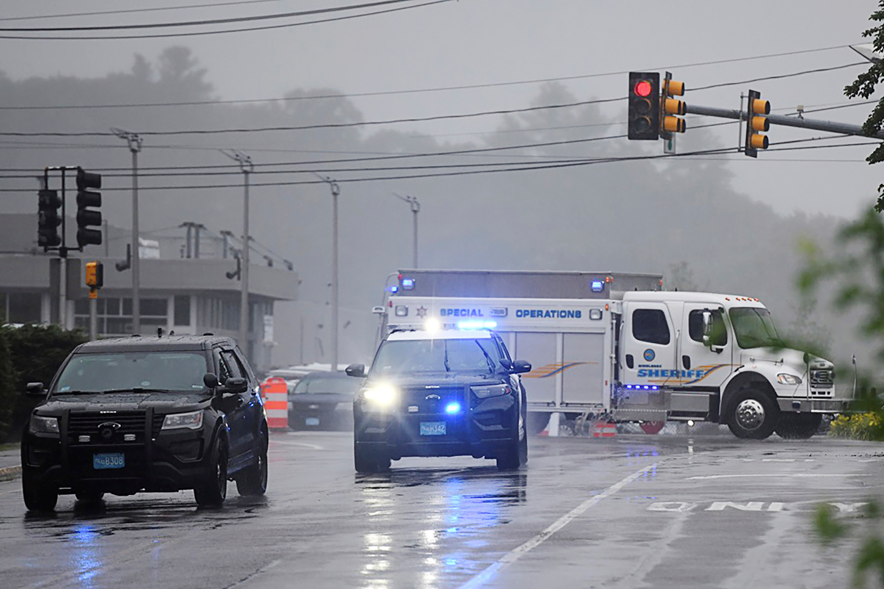 A Special Operations unit arrives after state police announced they were conducting a search for armed persons following a traffic stop in Wakefield, Massachusetts, U.S. July 3, 2021.  REUTERS/Faith Ninivaggi