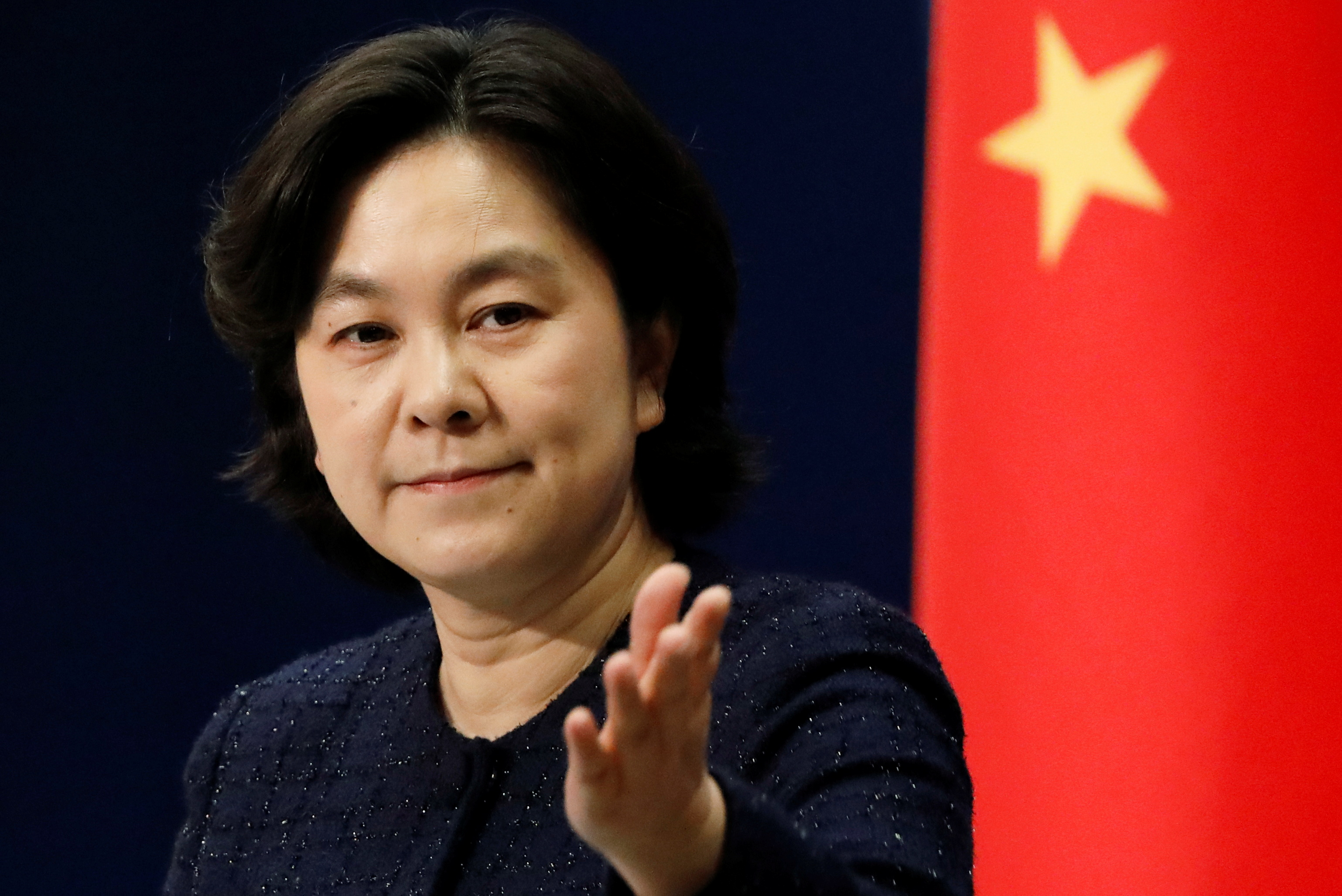 Chinese Foreign Ministry spokeswoman Hua Chunying attends a news conference in Beijing, China January 21, 2021. REUTERS/Carlos Garcia Rawlins