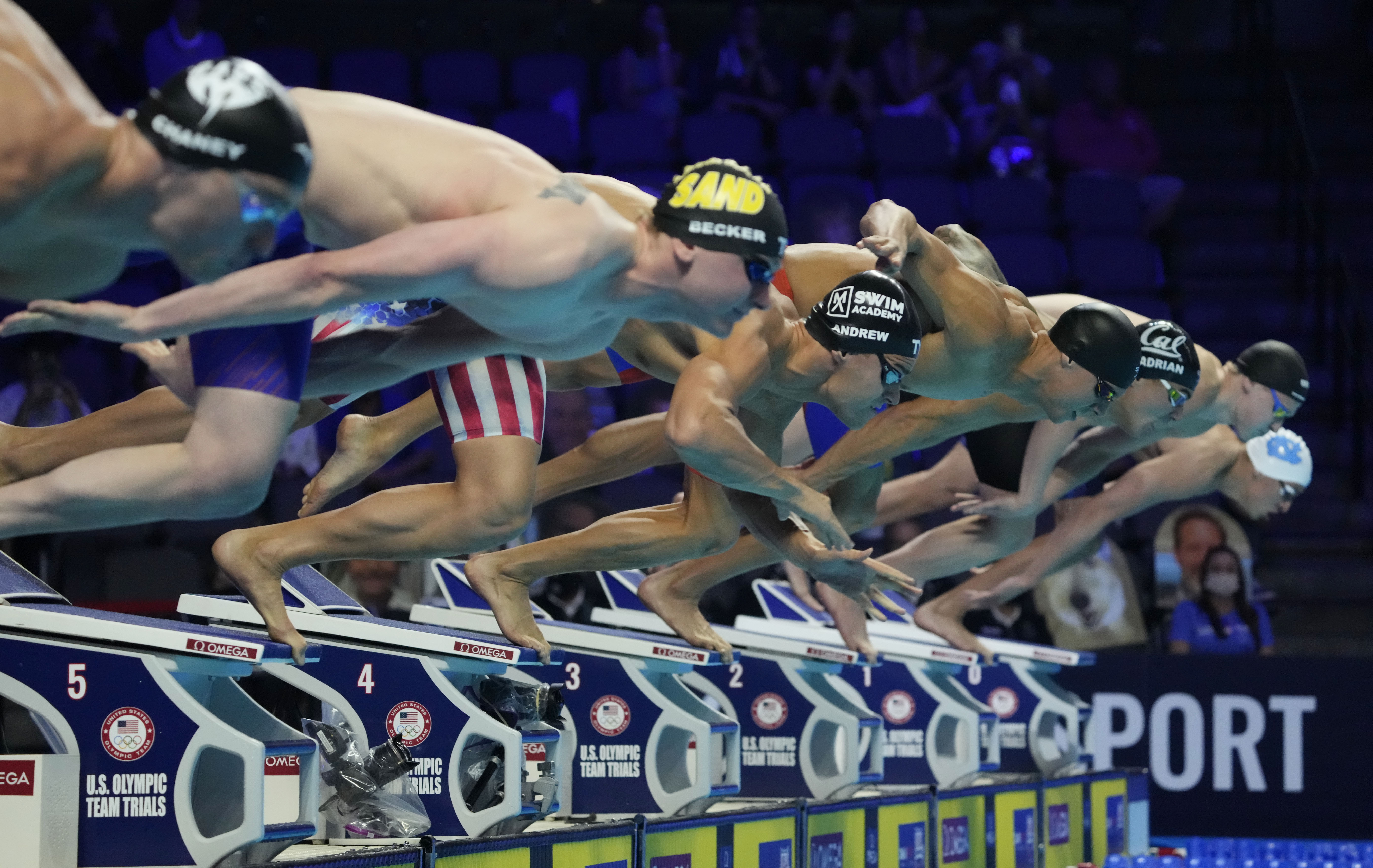 Jun 20, 2021; Omaha, Nebraska, USA; Michael Andrew dives off the starting block for the men's 50m freestyle during the U.S. Olympic Team Trials Swimming competition at CHI Health Center Omaha. Mandatory Credit: Rob Schumacher-USA TODAY Sports