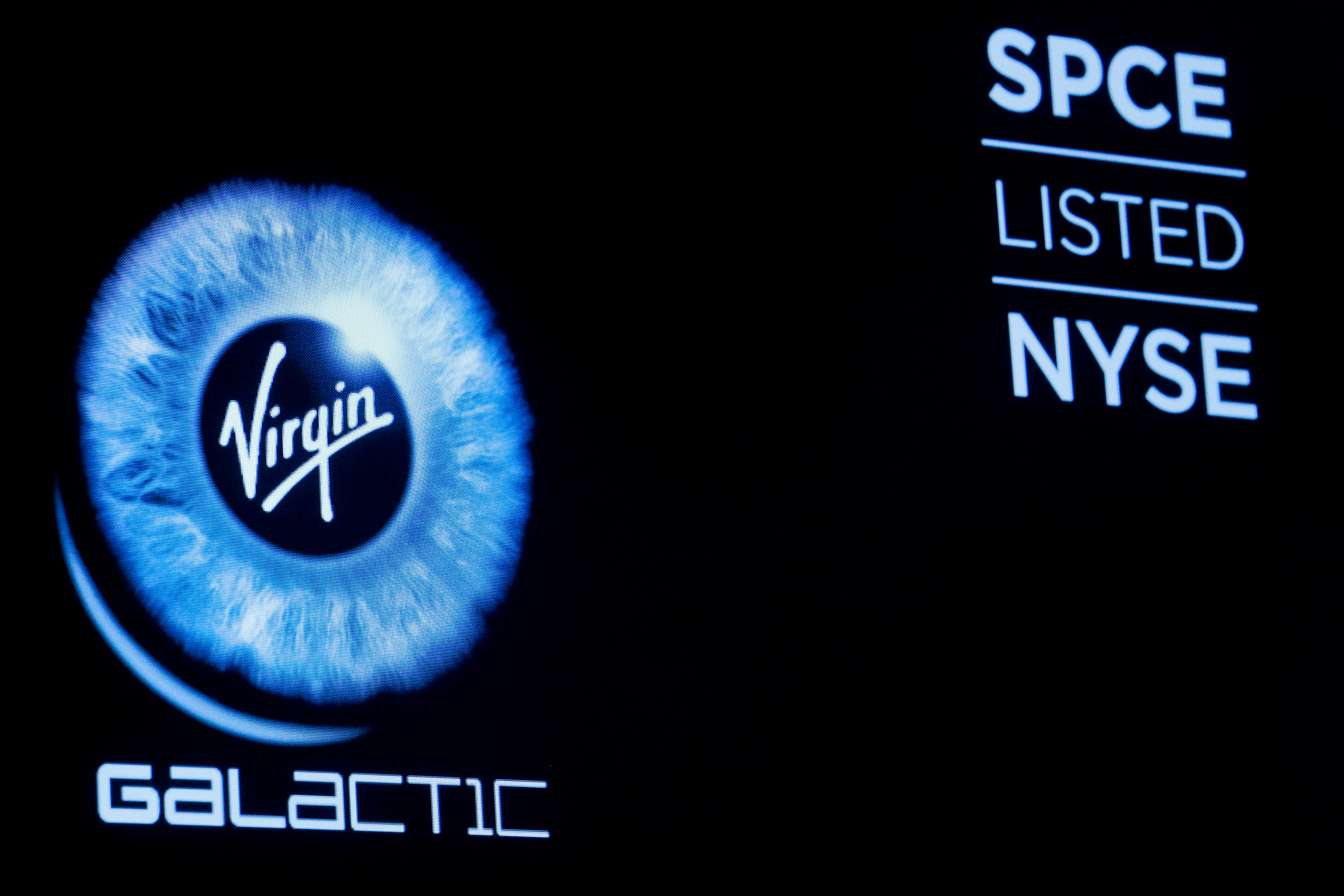 Virgin Galactic (SPCE) logo is displayed on a screen on the floor of the New York Stock Exchange (NYSE) as the company begins public trading in New York, U.S., October 28, 2019. REUTERS/Brendan McDermid