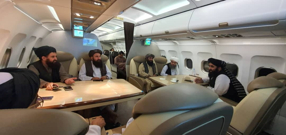 Taliban delegates are seated in a plane in an unidentified location, in this handout photo uploaded to social media on October 9, 2021. Picture uploaded on on October 9, 2021. Social media handout/via REUTERS