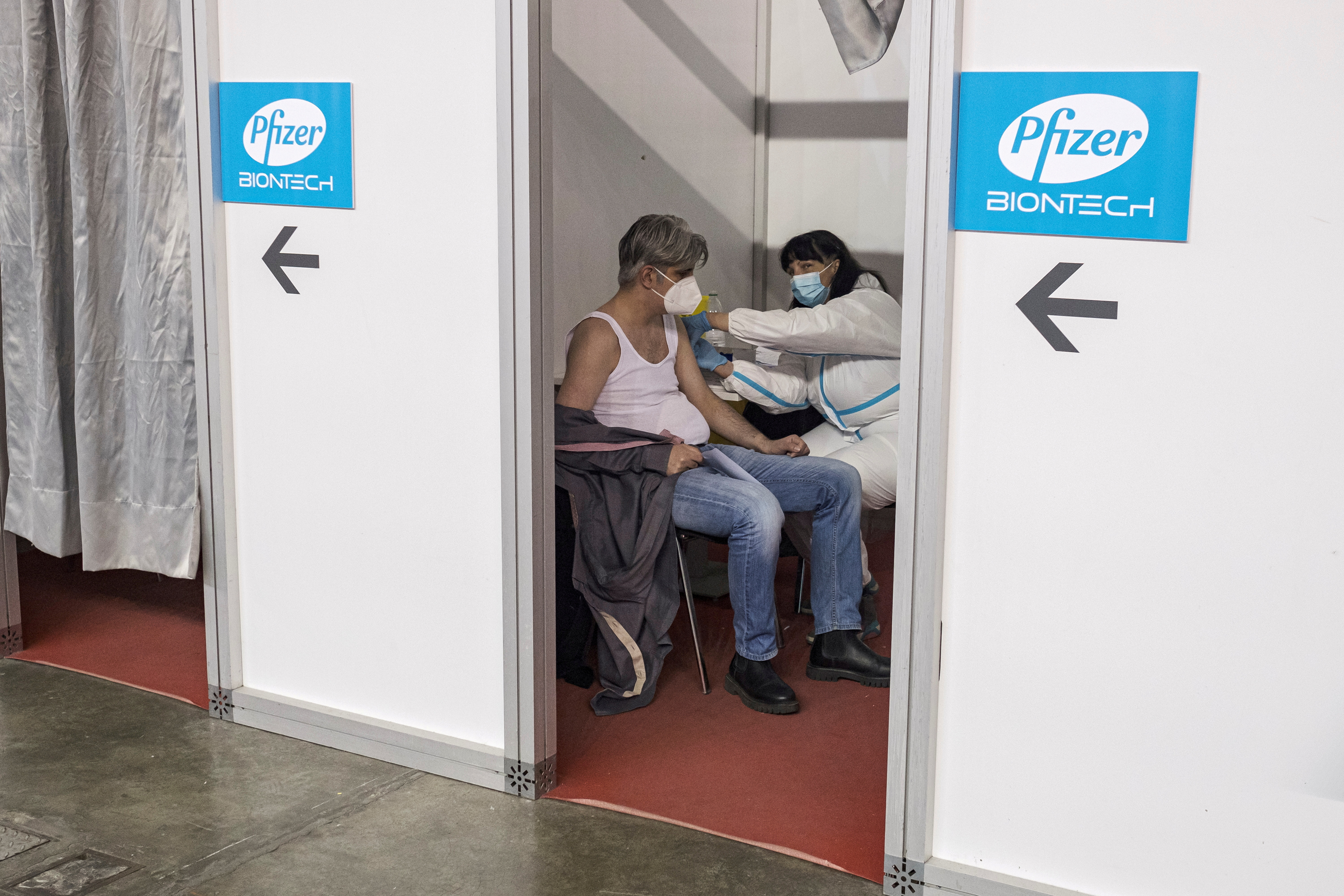 A man receives a second dose of the Pfizer-BioNTech vaccine against the coronavirus disease (COVID-19) at the hall three of the Belgrade Fair, in Belgrade, Serbia, April 13, 2021. REUTERS/Marko Djurica/File Photo
