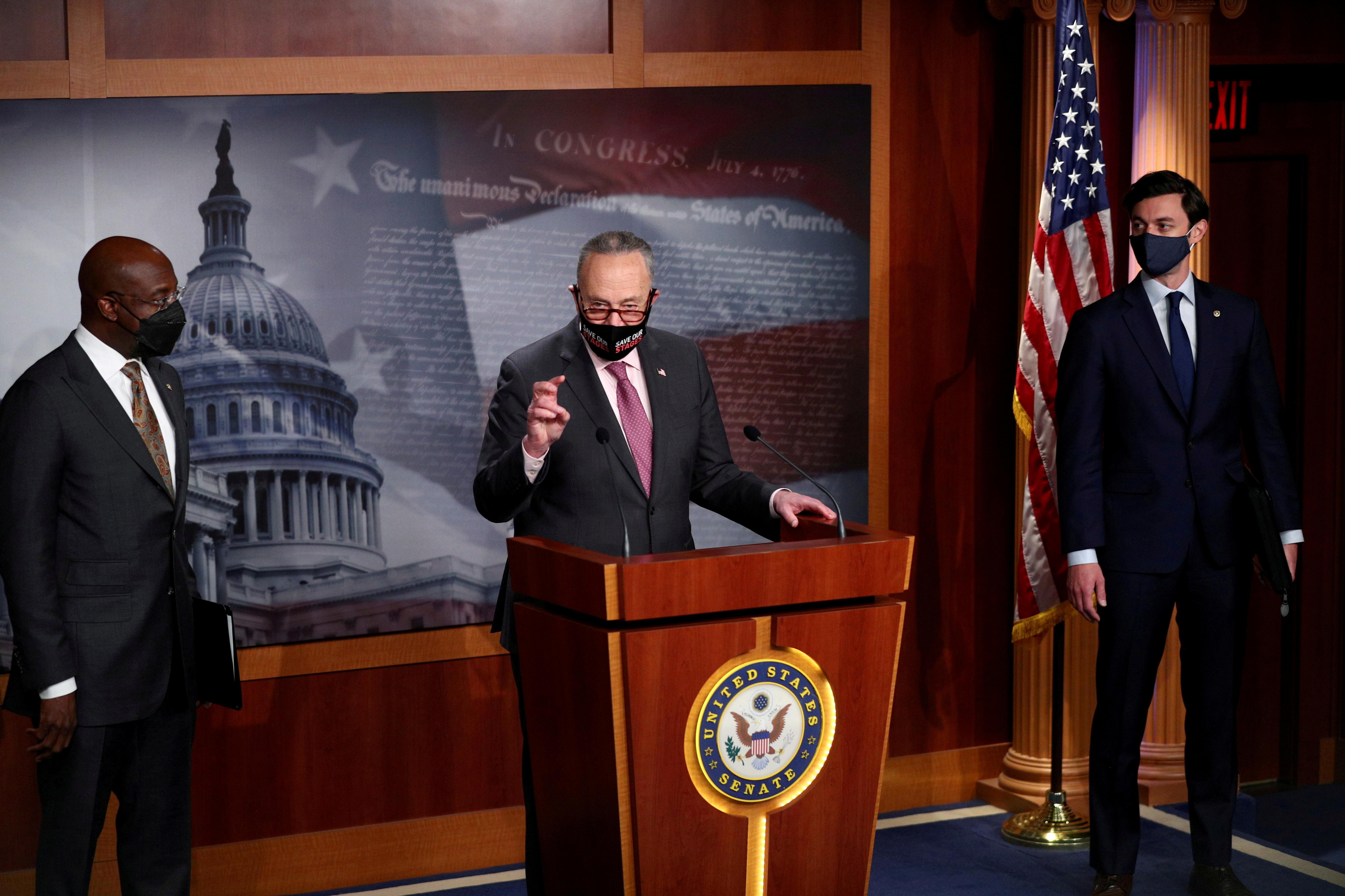 Senate Majority Leader Chuck Schumer (D-NY) delivers remarks beside Senators Jon Ossoff and Raphael Warnock (D-GA) on COVID-19 relief, amid the coronavirus disease (COVID-19) outbreak, on Capitol Hill in Washington, U.S., February 11, 2021. REUTERS/Tom Brenner/File Photo