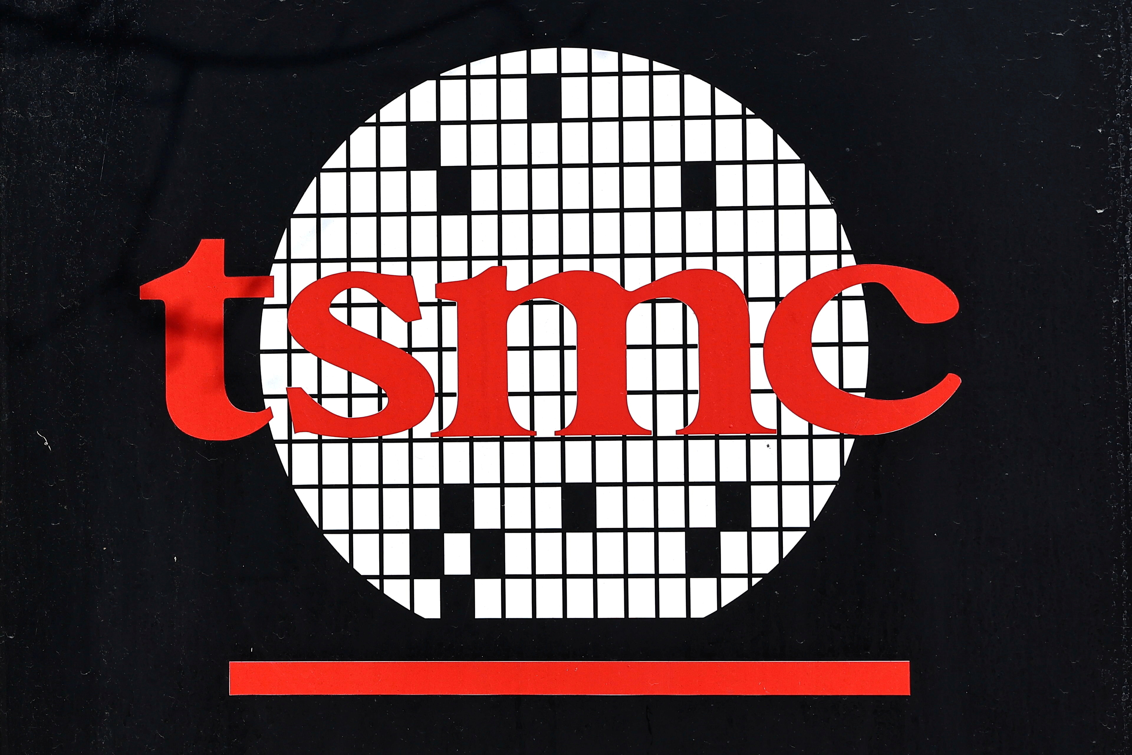 The logo of Taiwan Semiconductor Manufacturing Co (TSMC) is pictured at its headquarters, in Hsinchu, Taiwan, January 19, 2021. REUTERS/Ann Wang