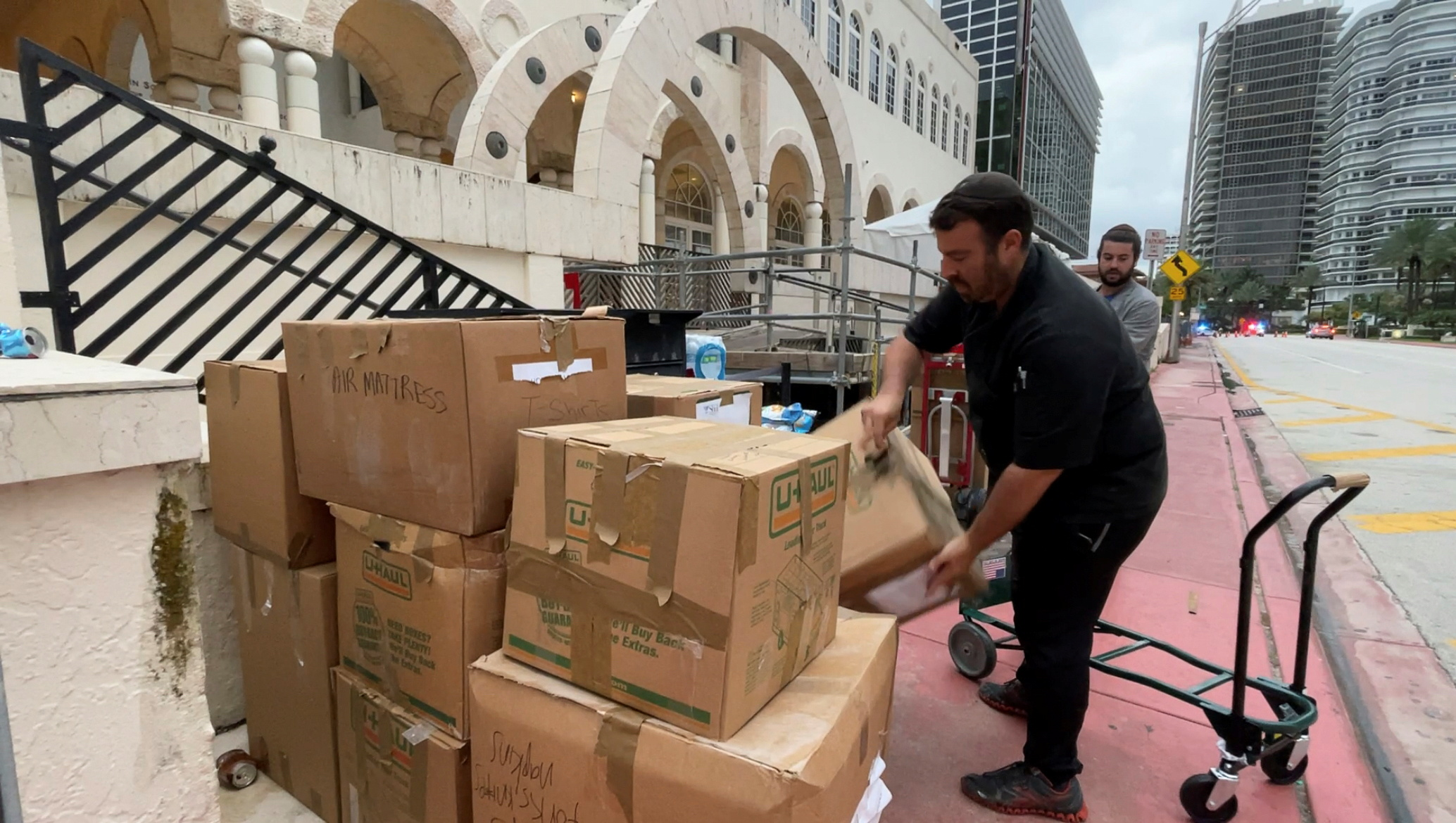 Volunteers pack boxes of donated goods to deliver to families of victims in Surfside, Florida, U.S. June 29, 2021. REUTERS/Katanga Johnson