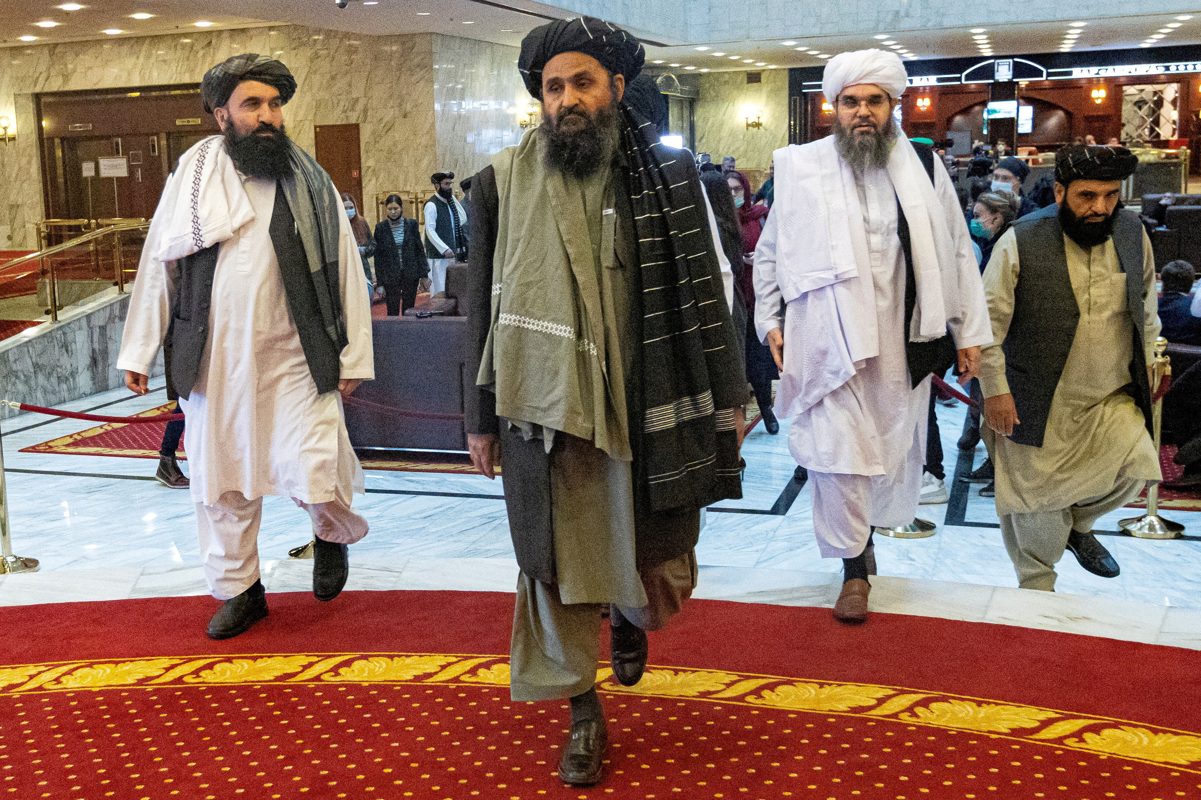 Mullah Abdul Ghani Baradar, the Taliban's deputy leader and negotiator, and other delegation members attend the Afghan peace conference in Moscow, Russia March 18, 2021. Alexander Zemlianichenko/Pool via REUTERS/File Photo/File Photo