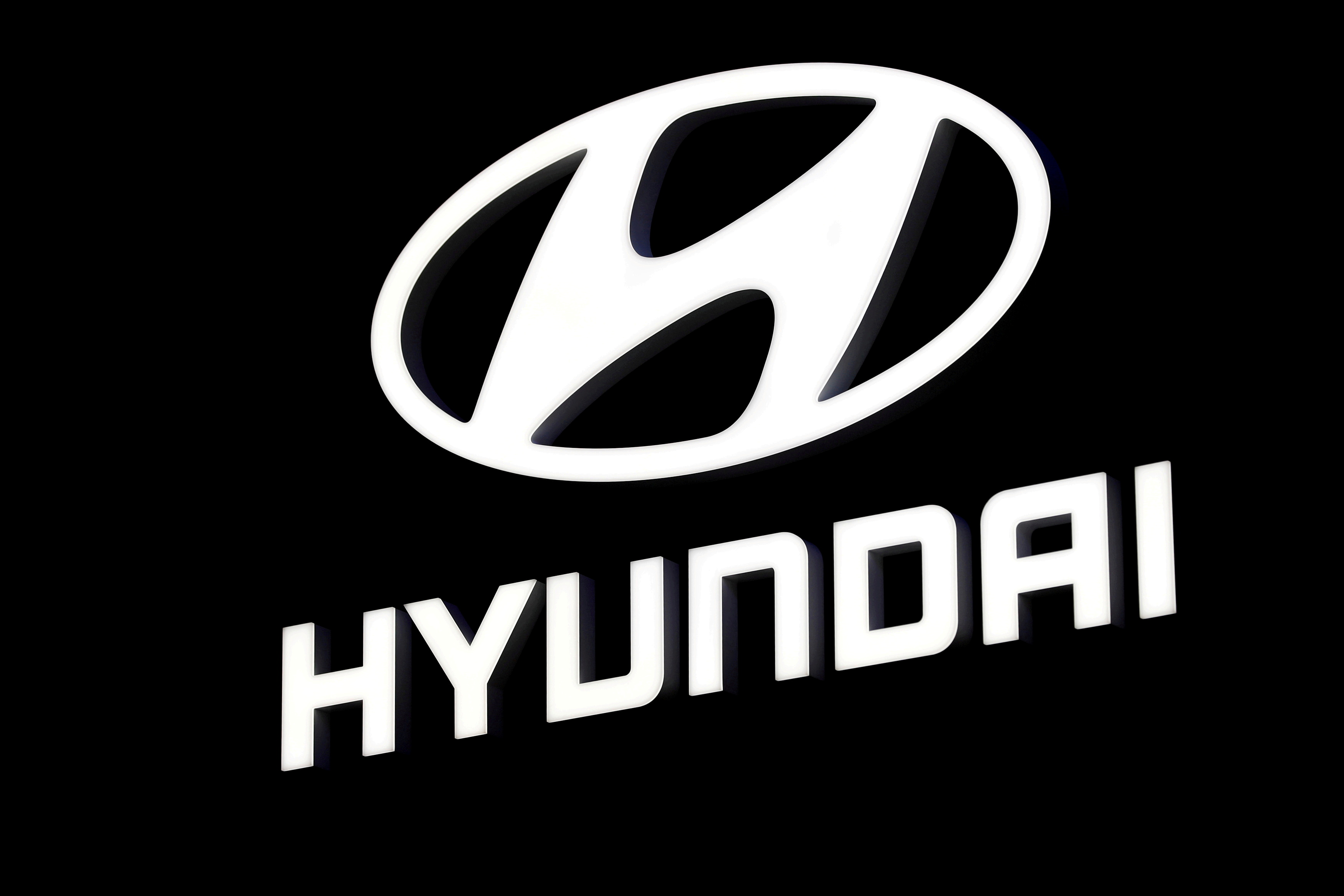 A Hyundai booth displays the company logo at the North American International Auto Show in Detroit, Michigan, U.S. January 16, 2018.  REUTERS/Jonathan Ernst/Files
