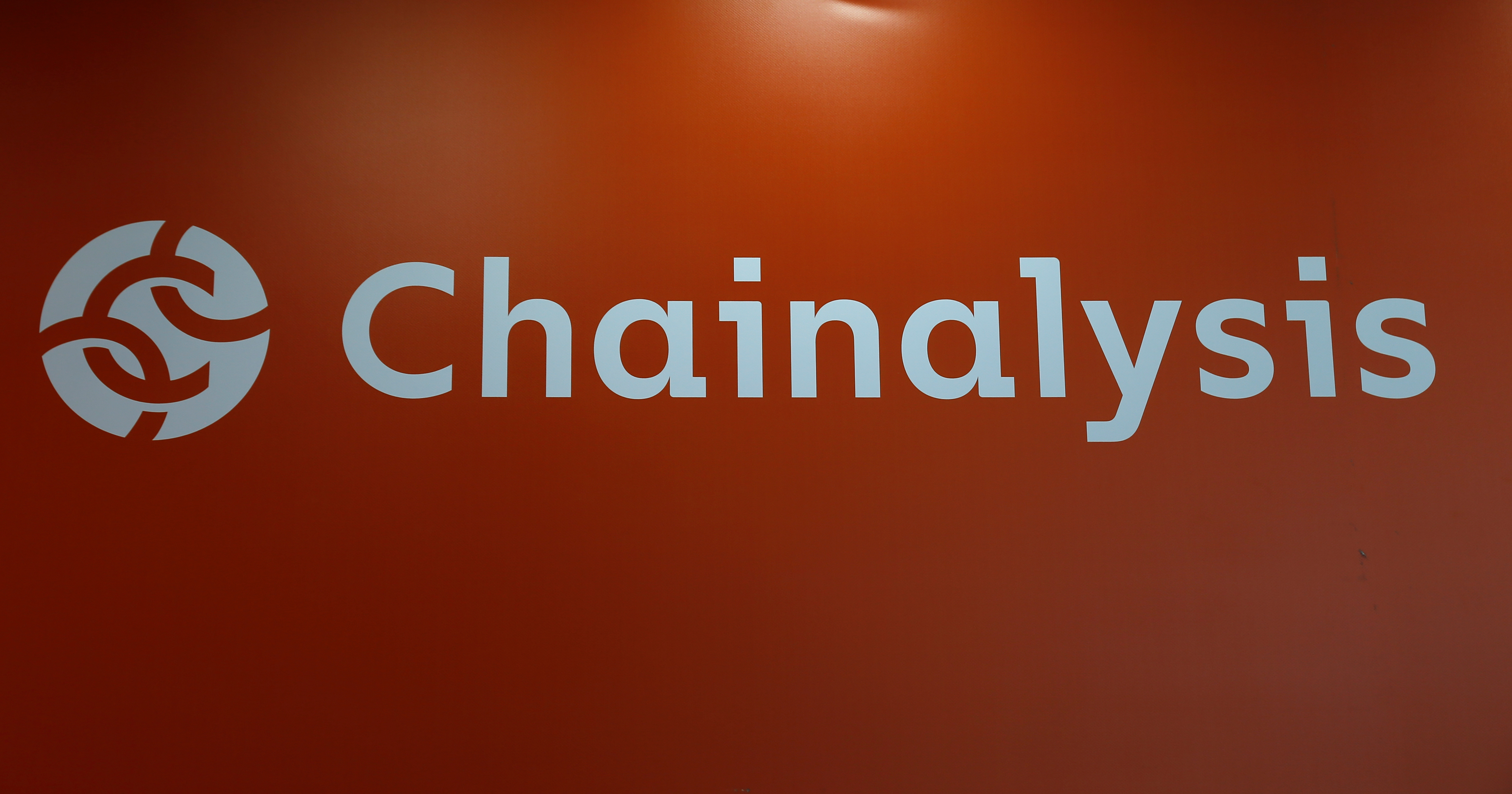 The logo of Chainalysis is seen on their exhibition stand at the Delta Summit, Malta