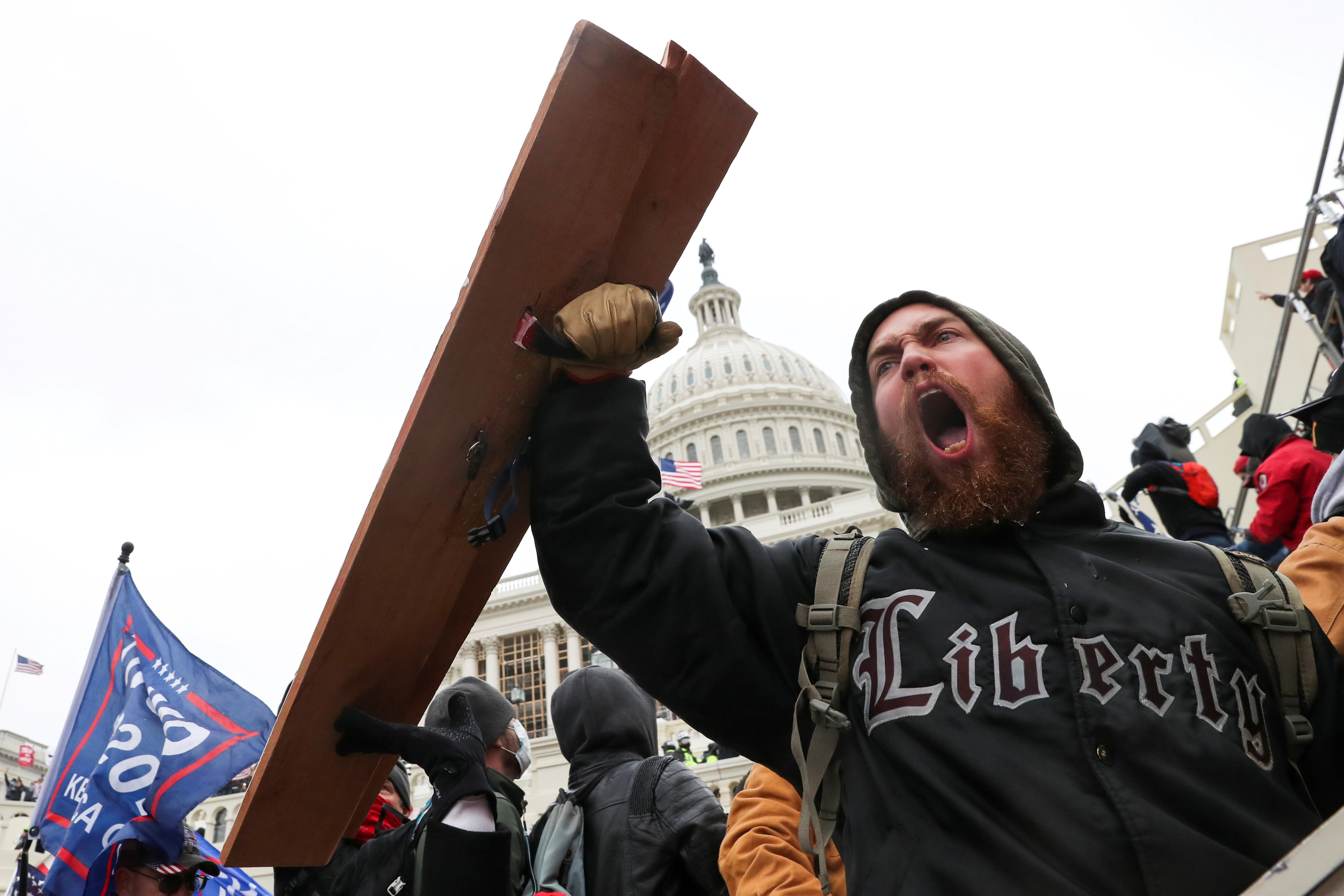 A man shouts as supporters of U.S. President Donald Trump gather in front of the U.S. Capitol Building in Washington, U.S., January 6, 2021. REUTERS/Leah Millis     TPX IMAGES OF THE DAY - RC2K2L9PX1RZ