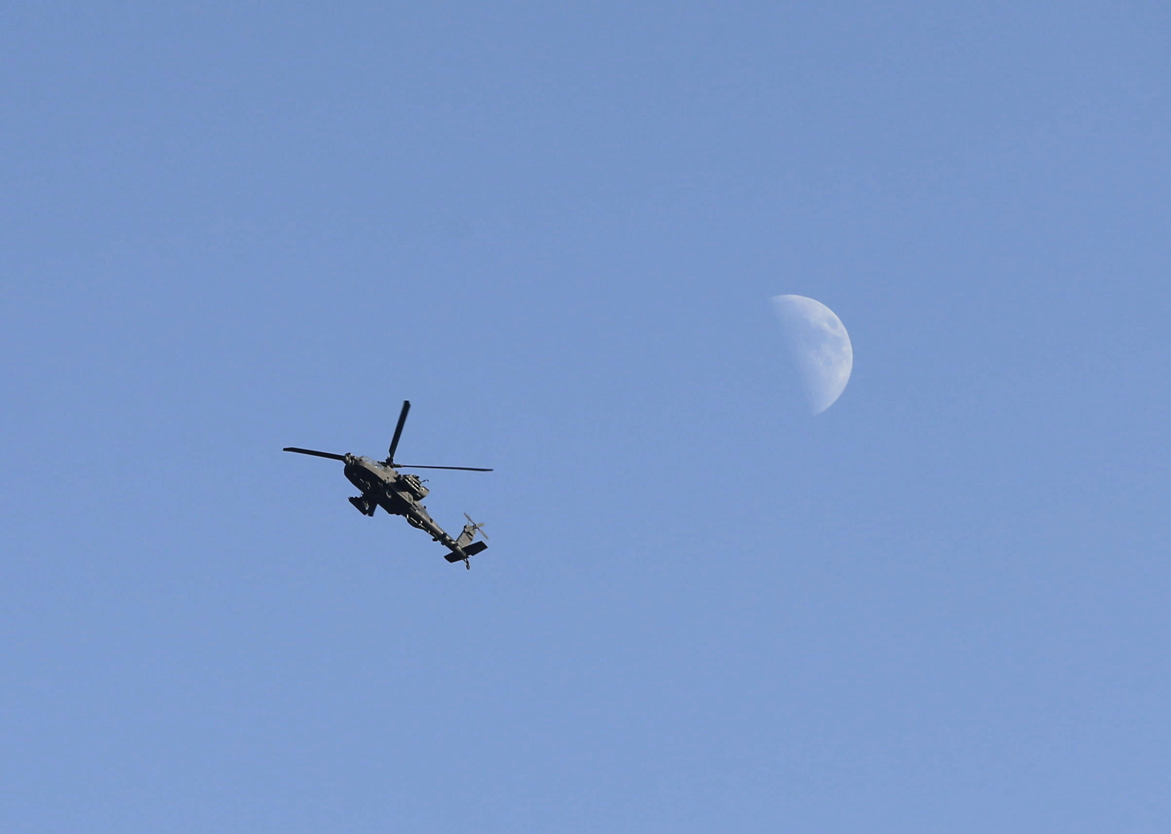 U.S. Army Apache helicopter flies over Kabul, Afghanistan August 15, 2021. REUTERS/Stringer